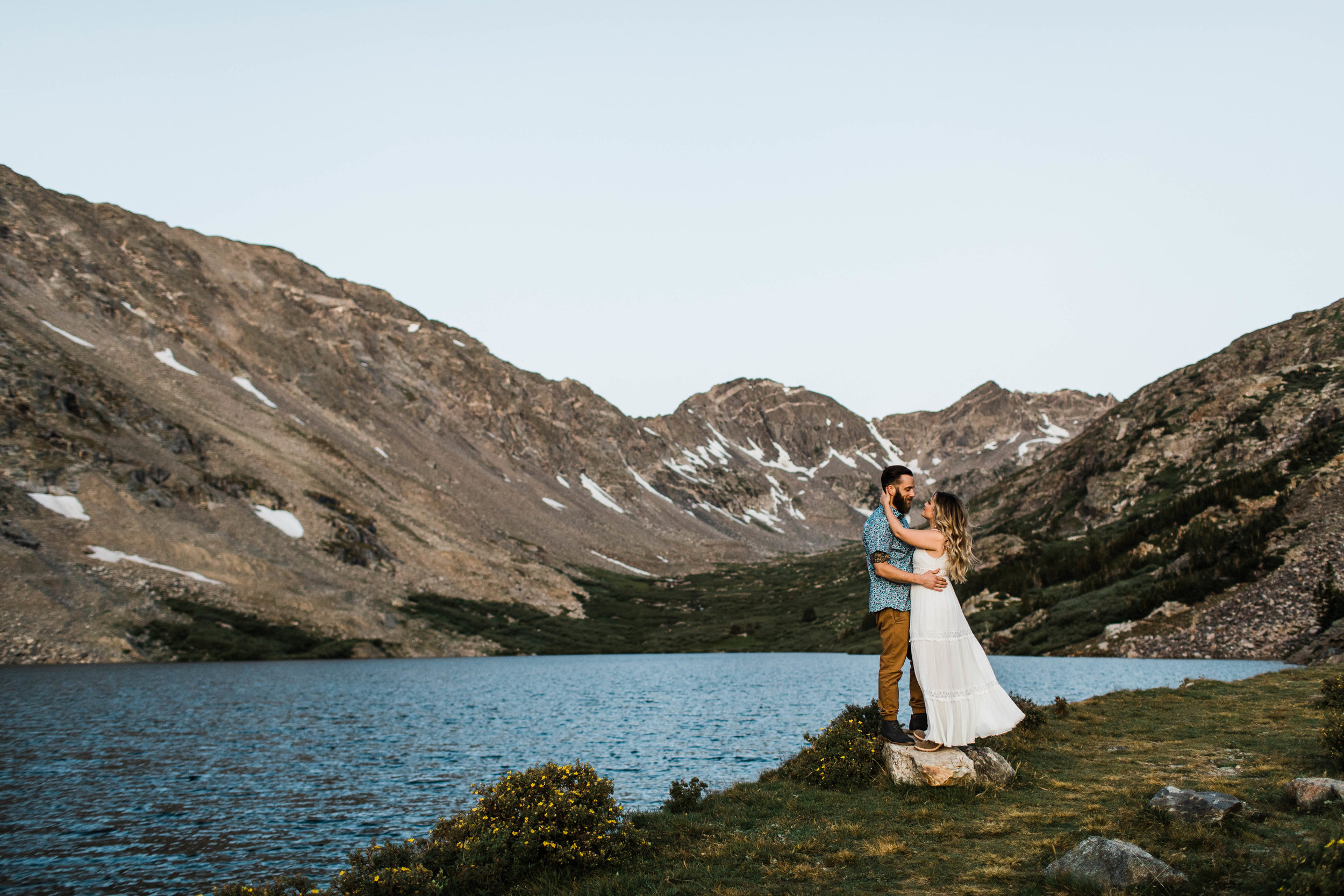 Engaged couple kissing during their Breckenridge adventure engagement photos at an alpine lake | Breckenridge elopement and wedding photographers