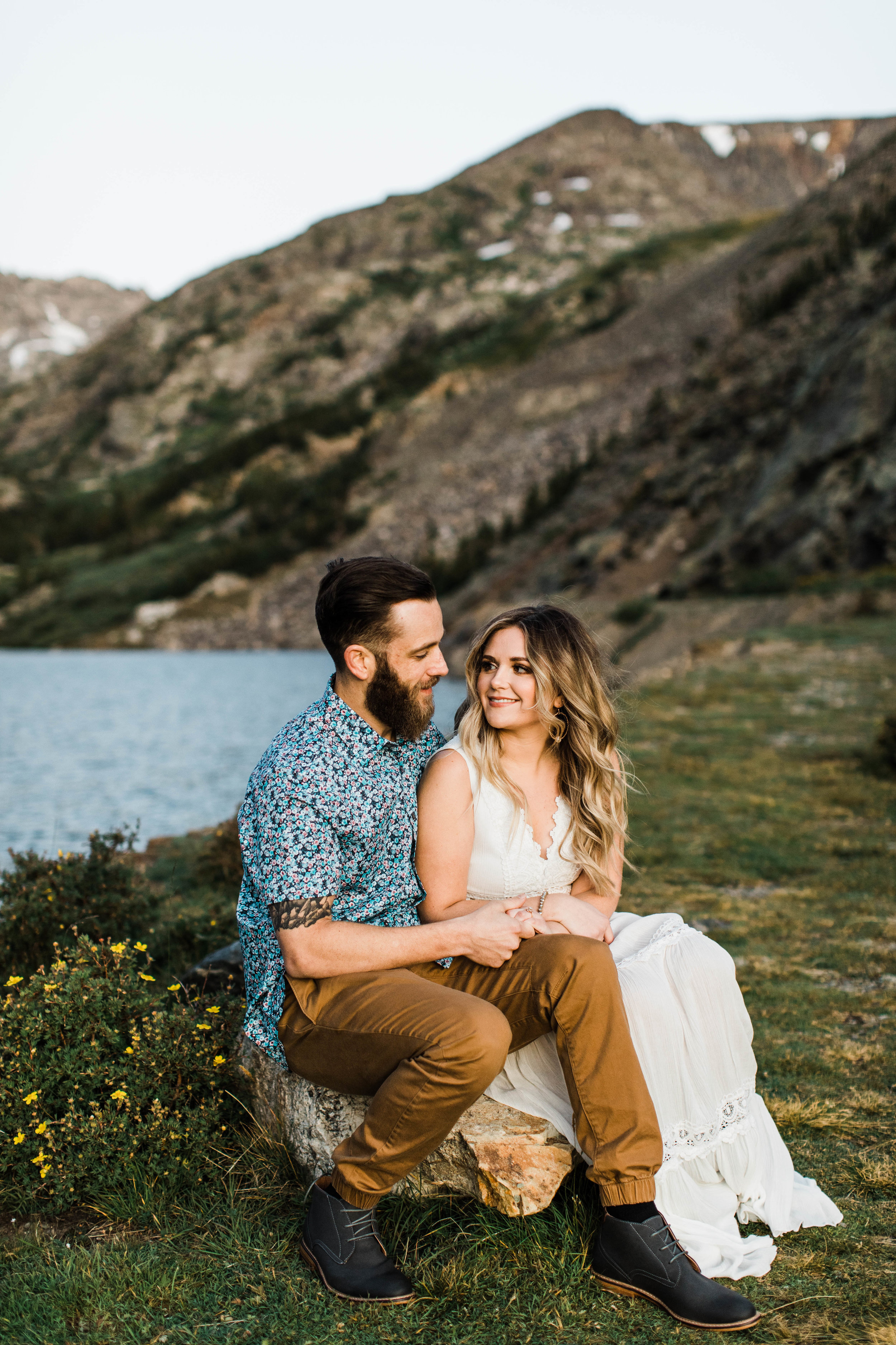 Engaged couple hanging out during their Breckenridge adventure engagement photos at an alpine lake | Breckenridge elopement and wedding photographers