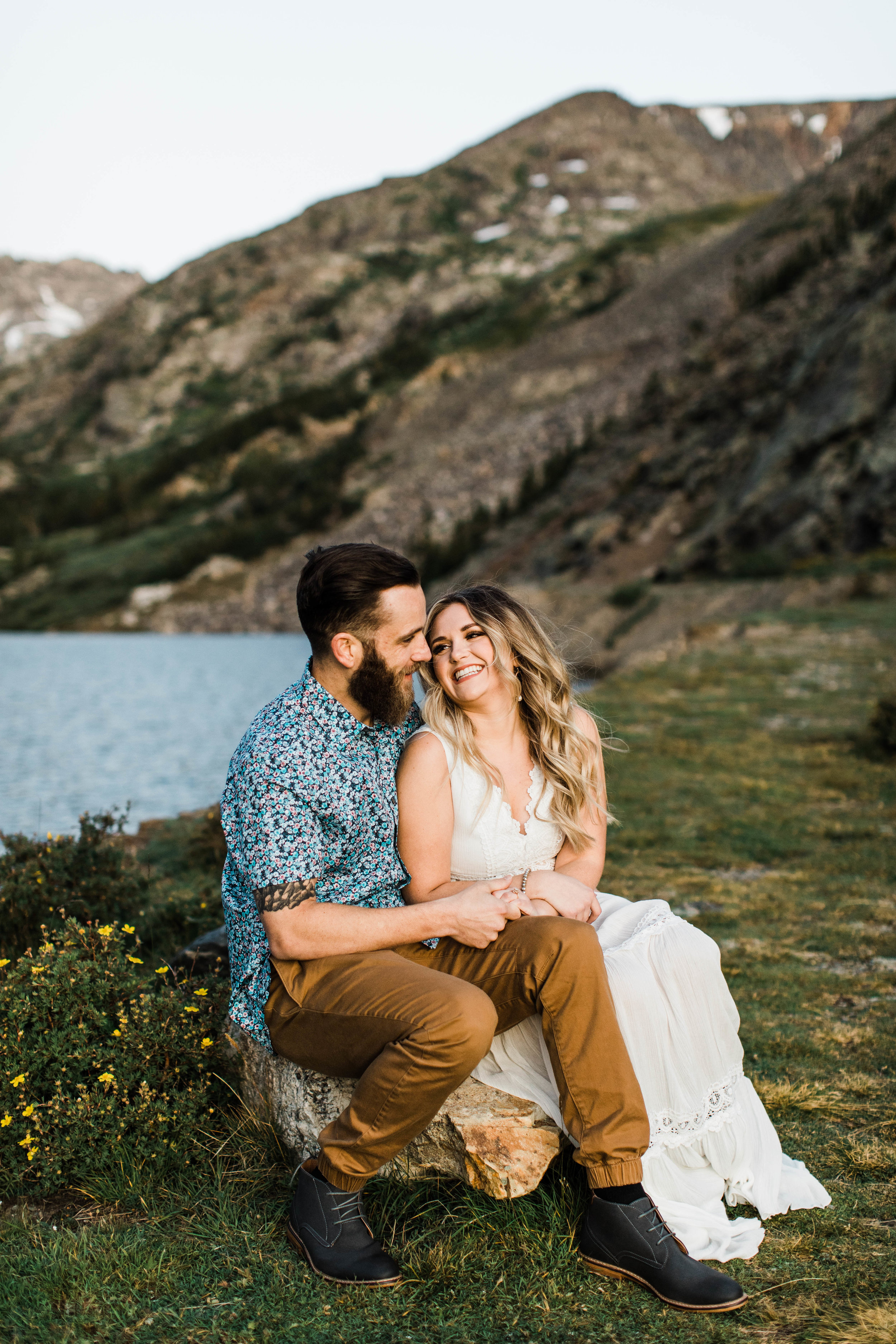 Engaged couples hanging out during their Breckenridge adventure engagement photos at an alpine lake | Breckenridge elopement in the Rocky Mountains