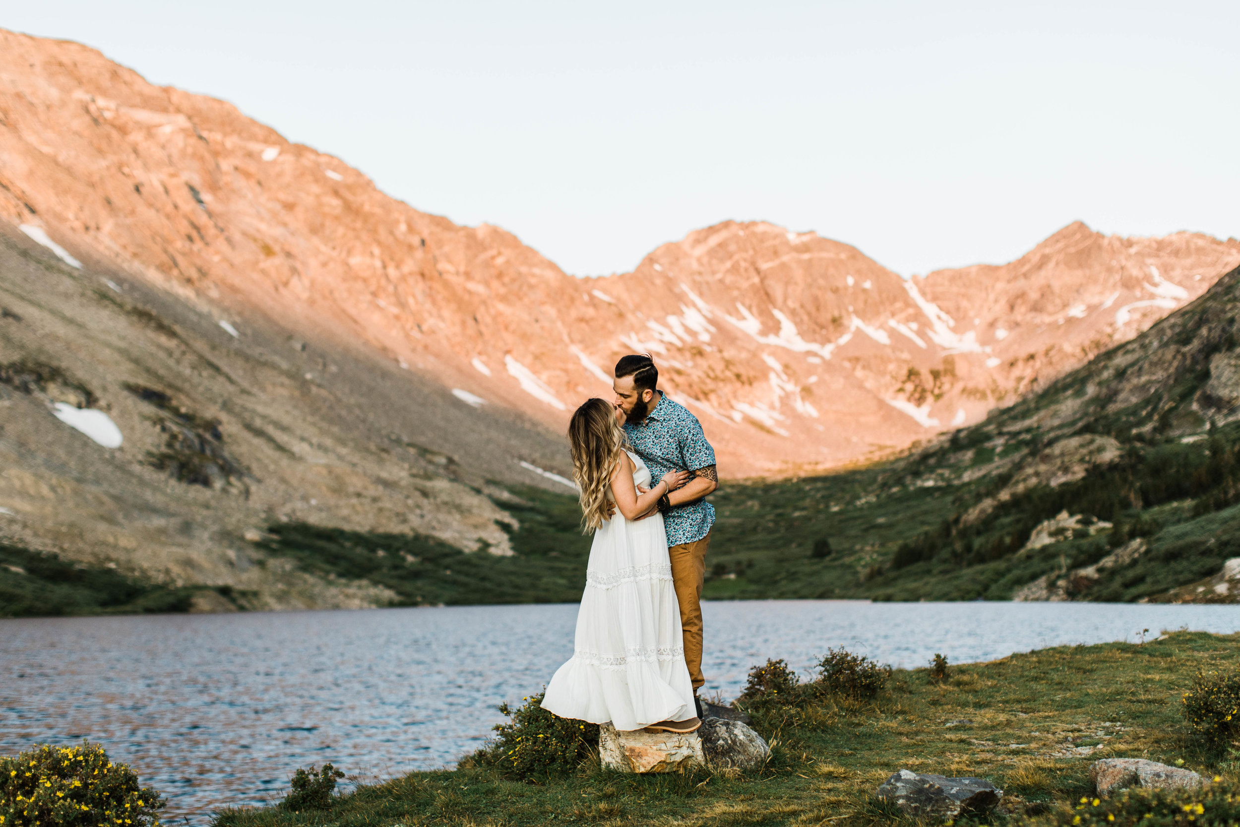 couple kissing in their wedding attire during their Breckenridge adventure session in the Colorado mountains | adventure elopement photographers near Breckenridge