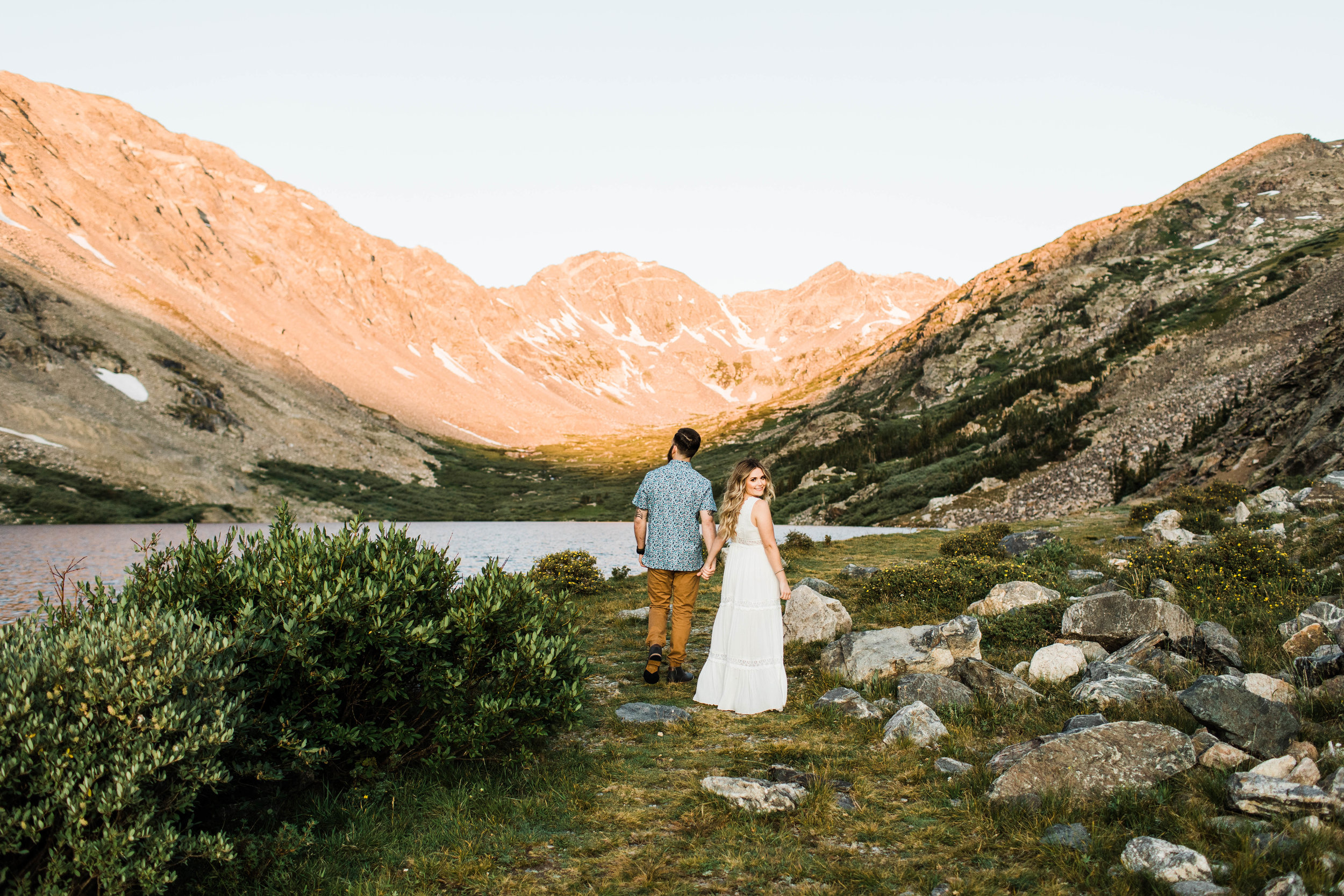 eloping couple walking through the mountains during their adventurous engagement photos in Breckenridge | Colorado elopement and Rocky Mountain wedding photographers