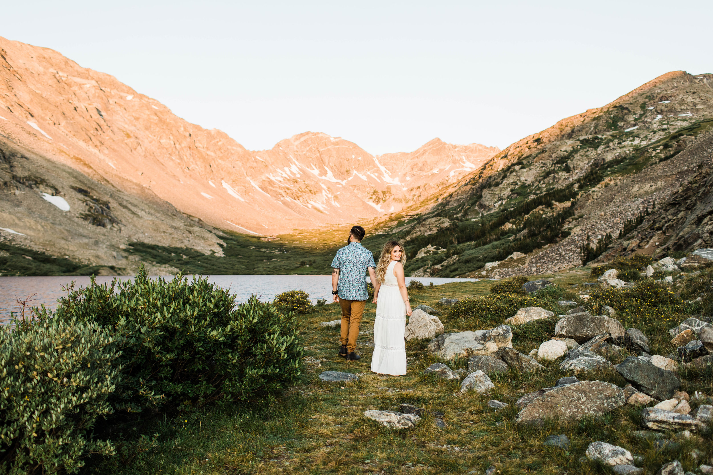 eloping couple walking through the mountains during their adventurous engagement photos in Breckenridge | Colorado elopement and mountainous wedding photographers