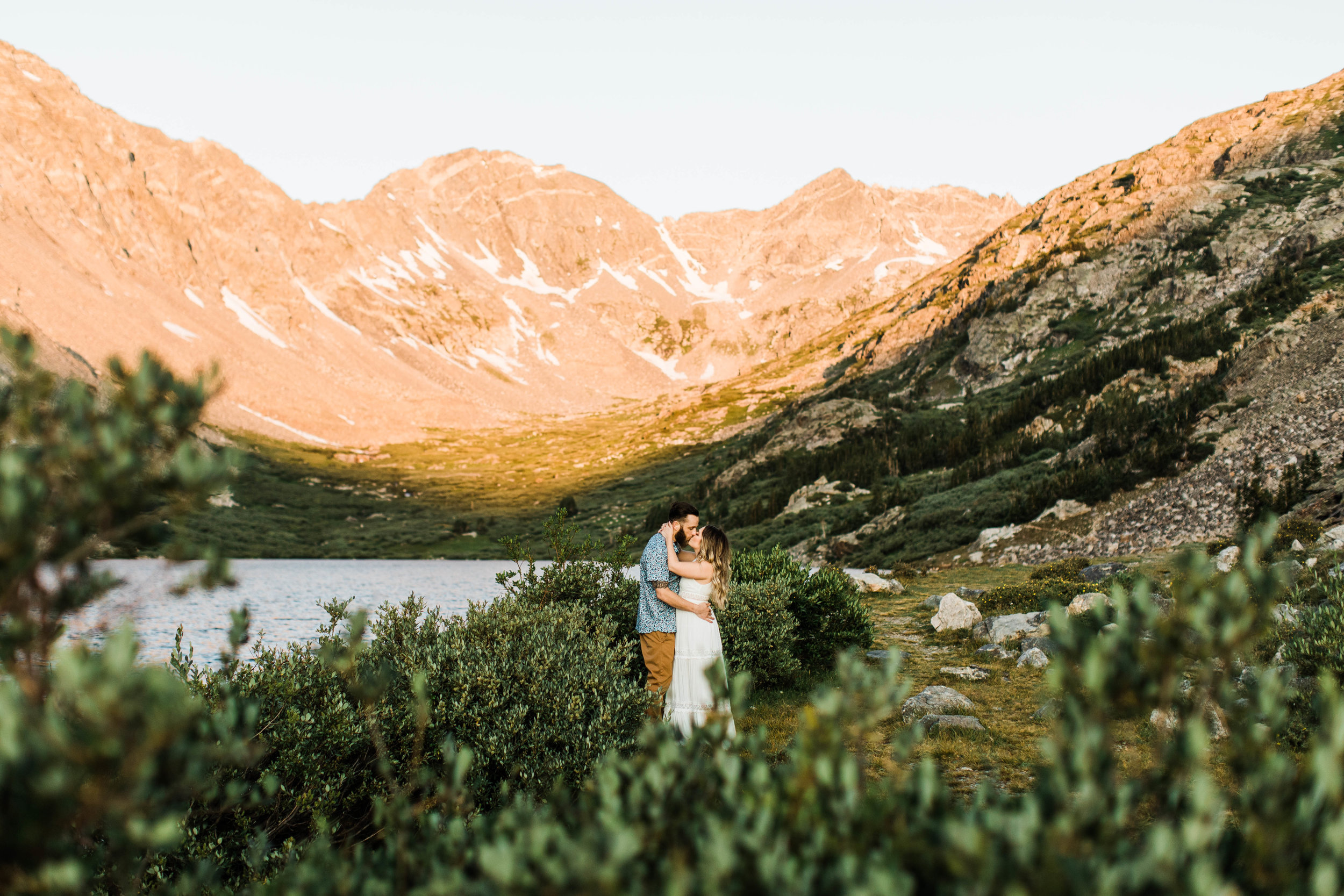 eloping couple slow dancing in the mountains during their adventurous engagement photos in Breckenridge | Colorado elopement and mountain wedding photographers