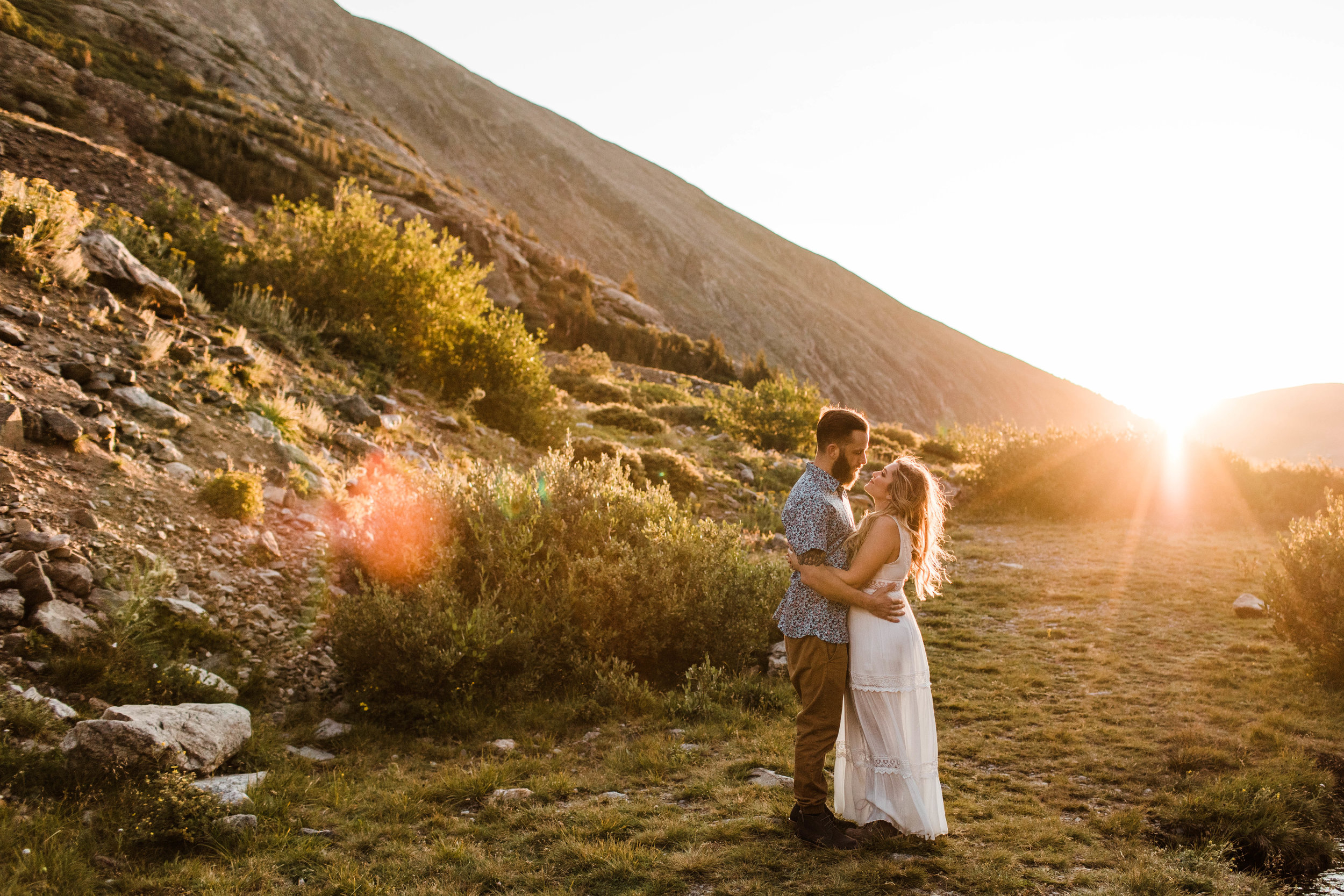 sunrise Breckenridge elopement style photos during an engaged couple's mountain adventure engagement photos | Breckenridge Colorado wedding photographers