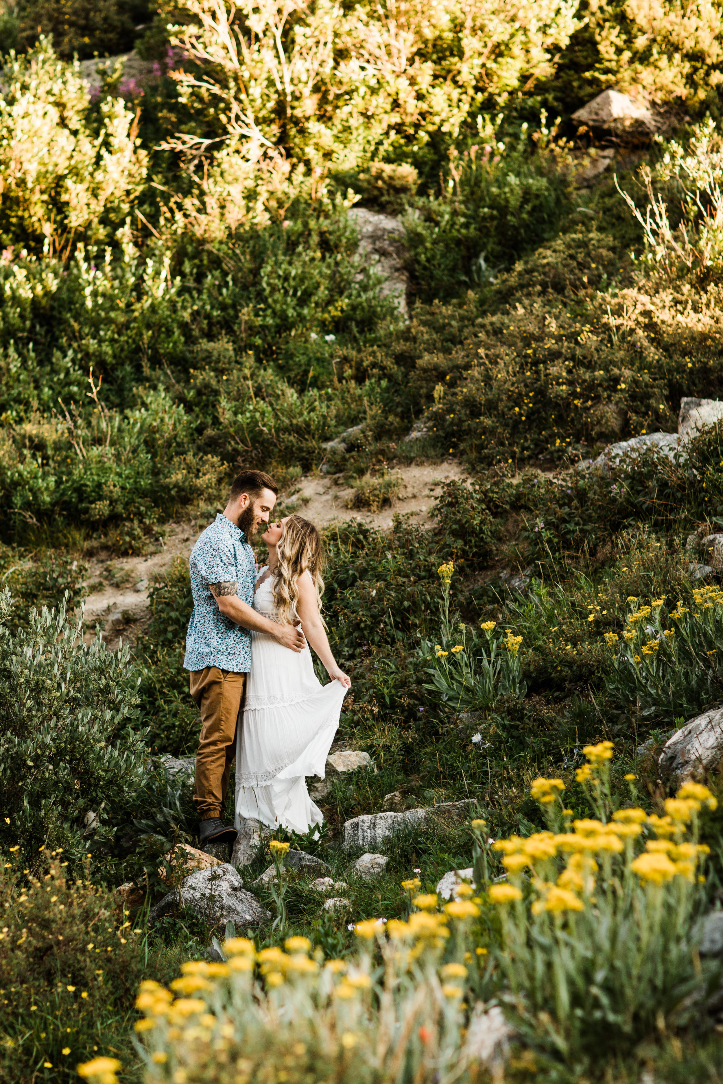 eloping couple kissing in an alpine wildflower field | Breckenridge elopement and adventure wedding photographers