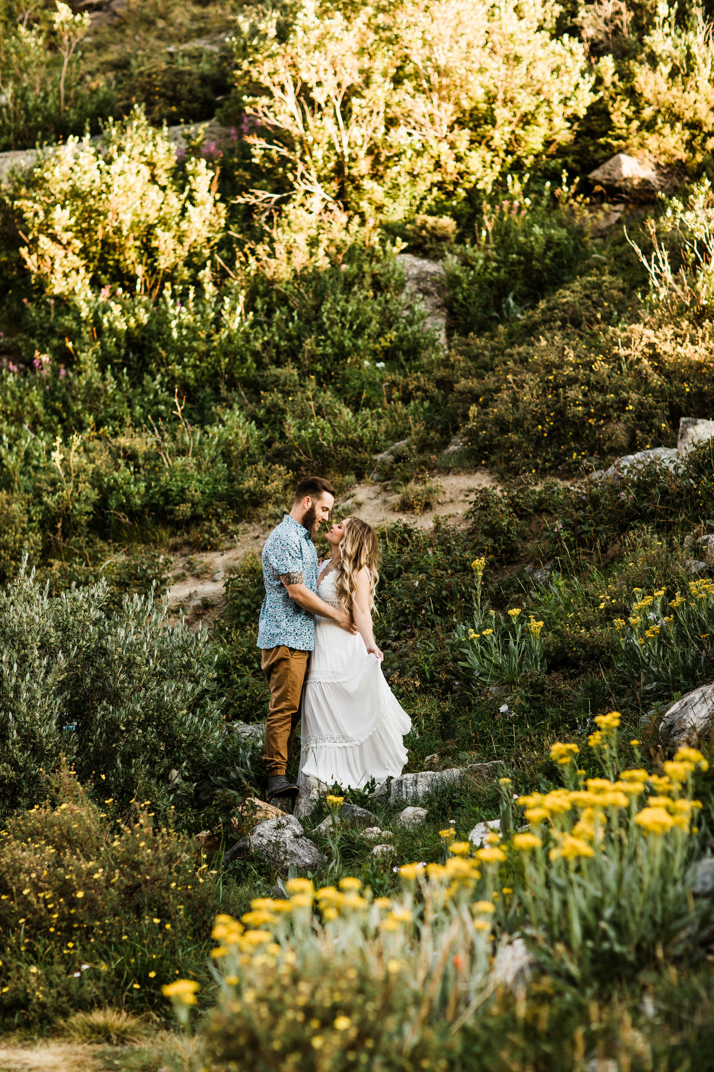 eloping couple kissing in an alpine wildflower field | Breckenridge elopement and mountain wedding photographers