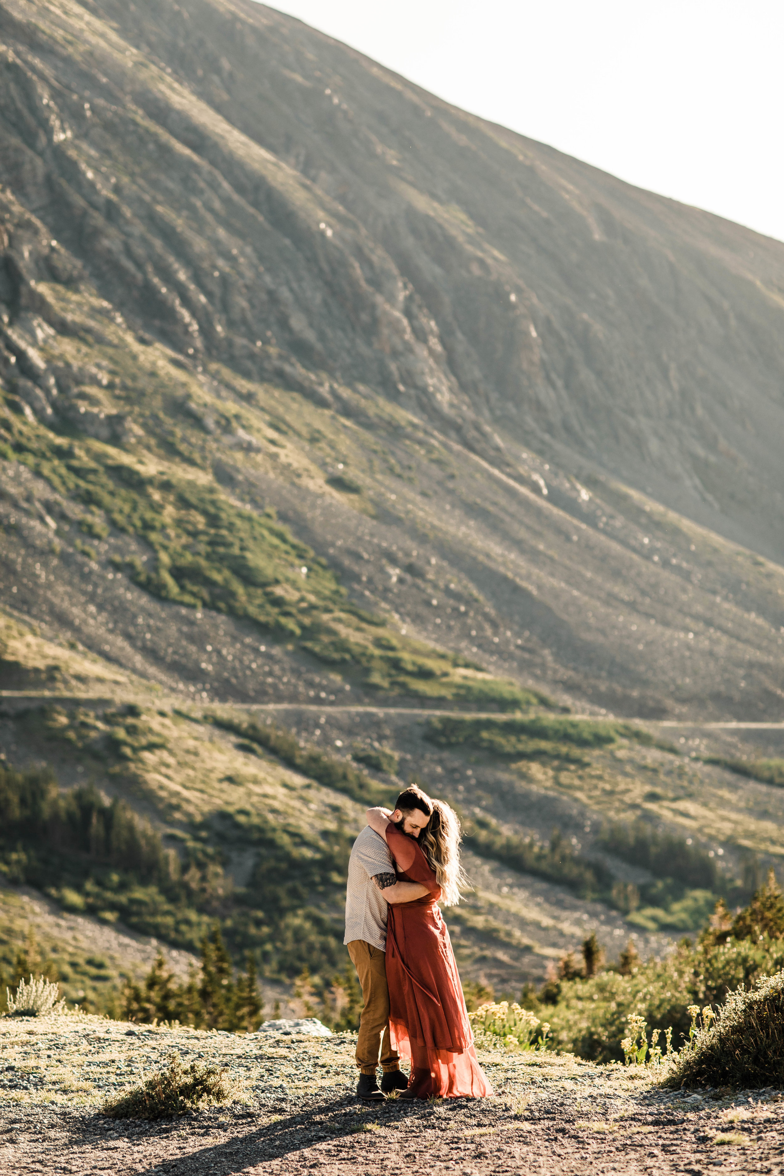 couple hugging in the mountains during their Breckenridge engagement session | Colorado adventure wedding and mountain elopement photographers