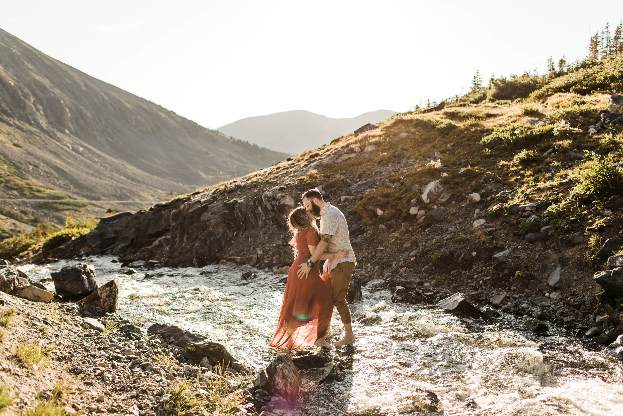 eloping couple kissing in the middle of a roaring creek in the Rocky Mountains of Colorado | Breckenridge adventure wedding photographers