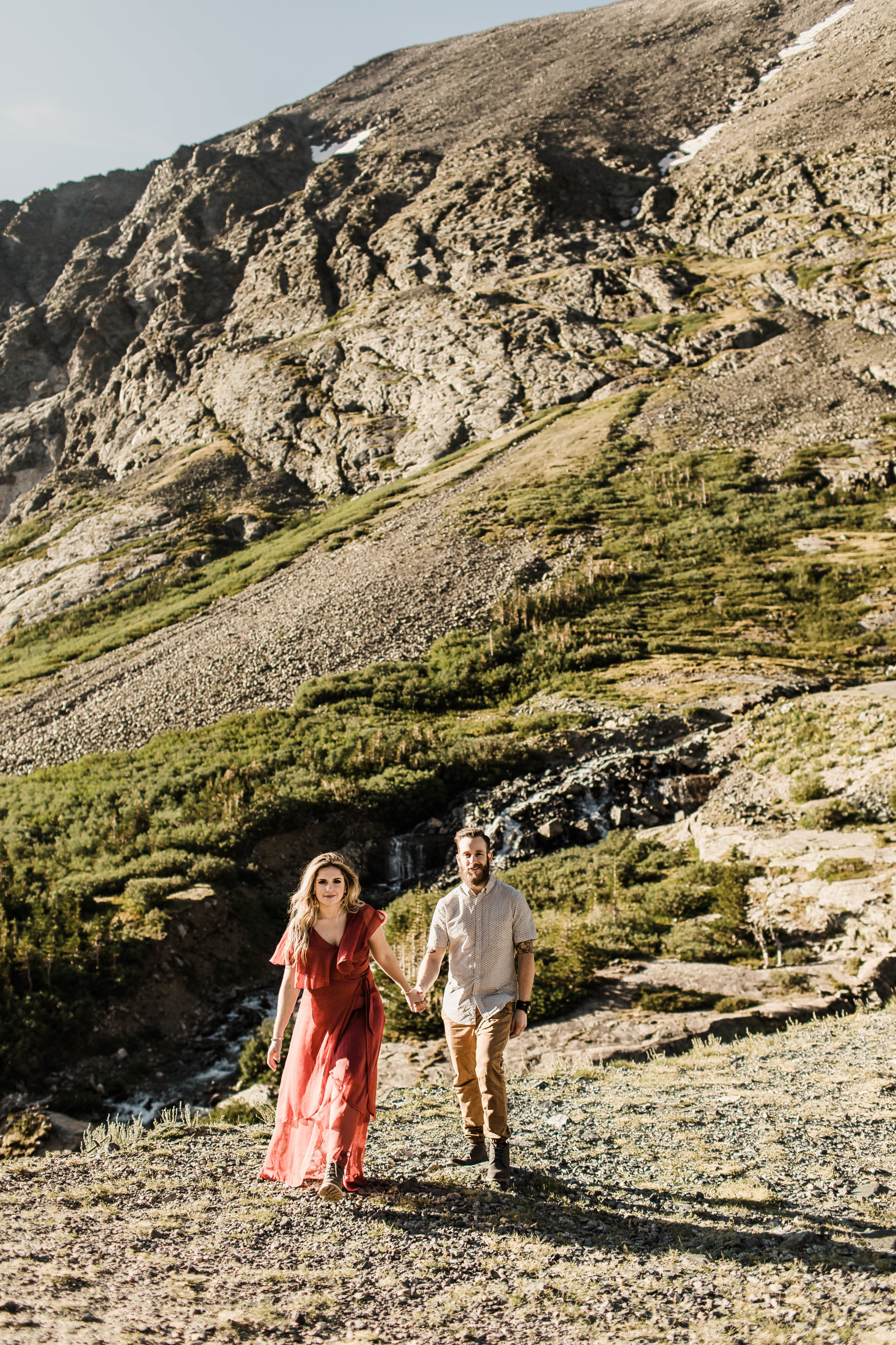 eloping couple walking through the Rocky Mountains of Colorado at sunrise | adventure wedding photographers in Breckenridge