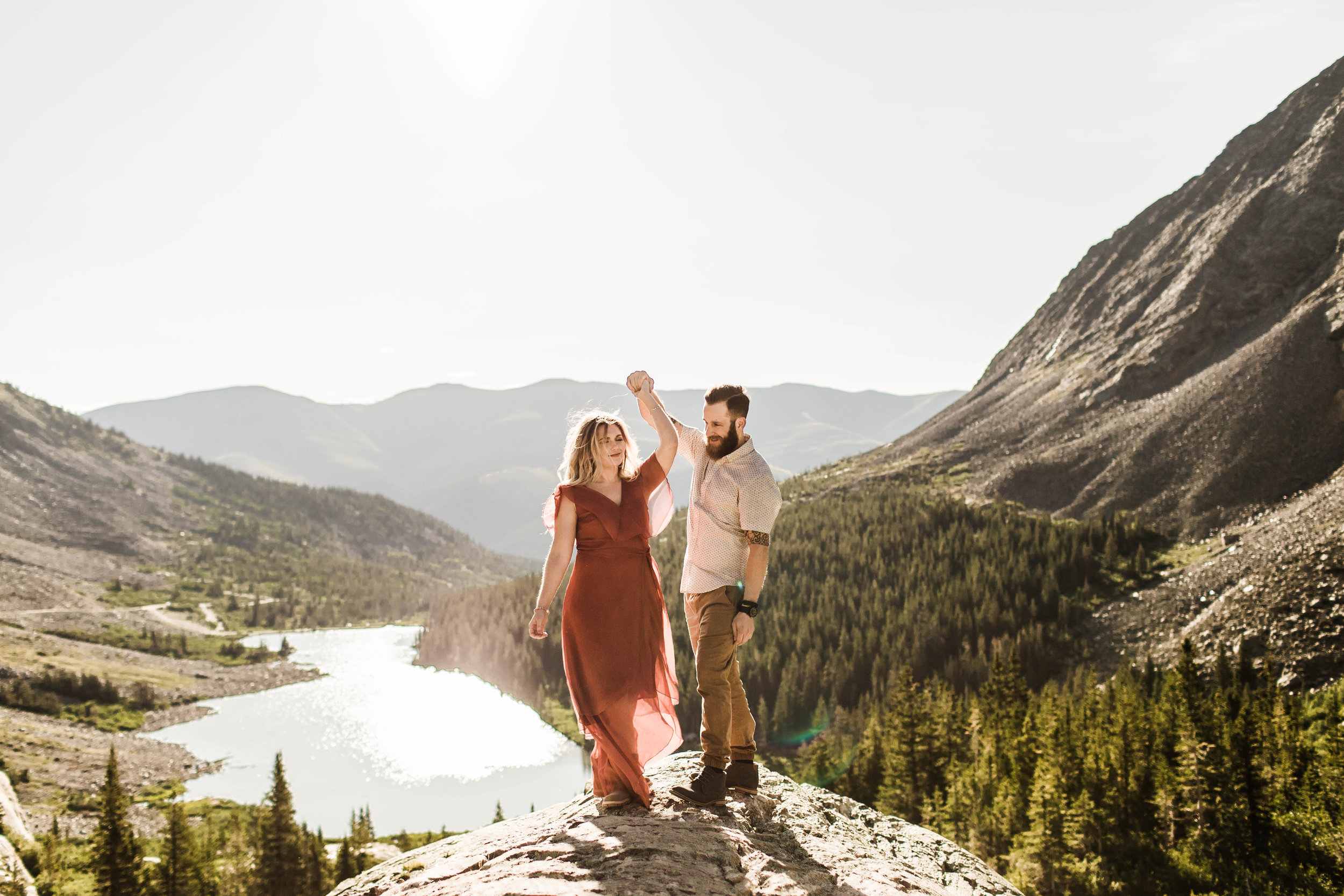 coupling planning to elope in Breckenridge dancing at sunrise on top of a mountain | adventurous Breckenridge wedding photographers