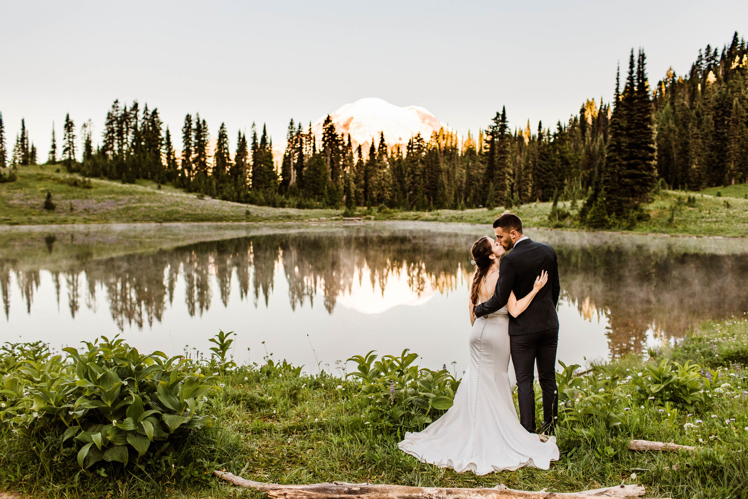 Couple eloping by a lake in Mount Rainier National Park in Washington state | Seattle elopement photographers
