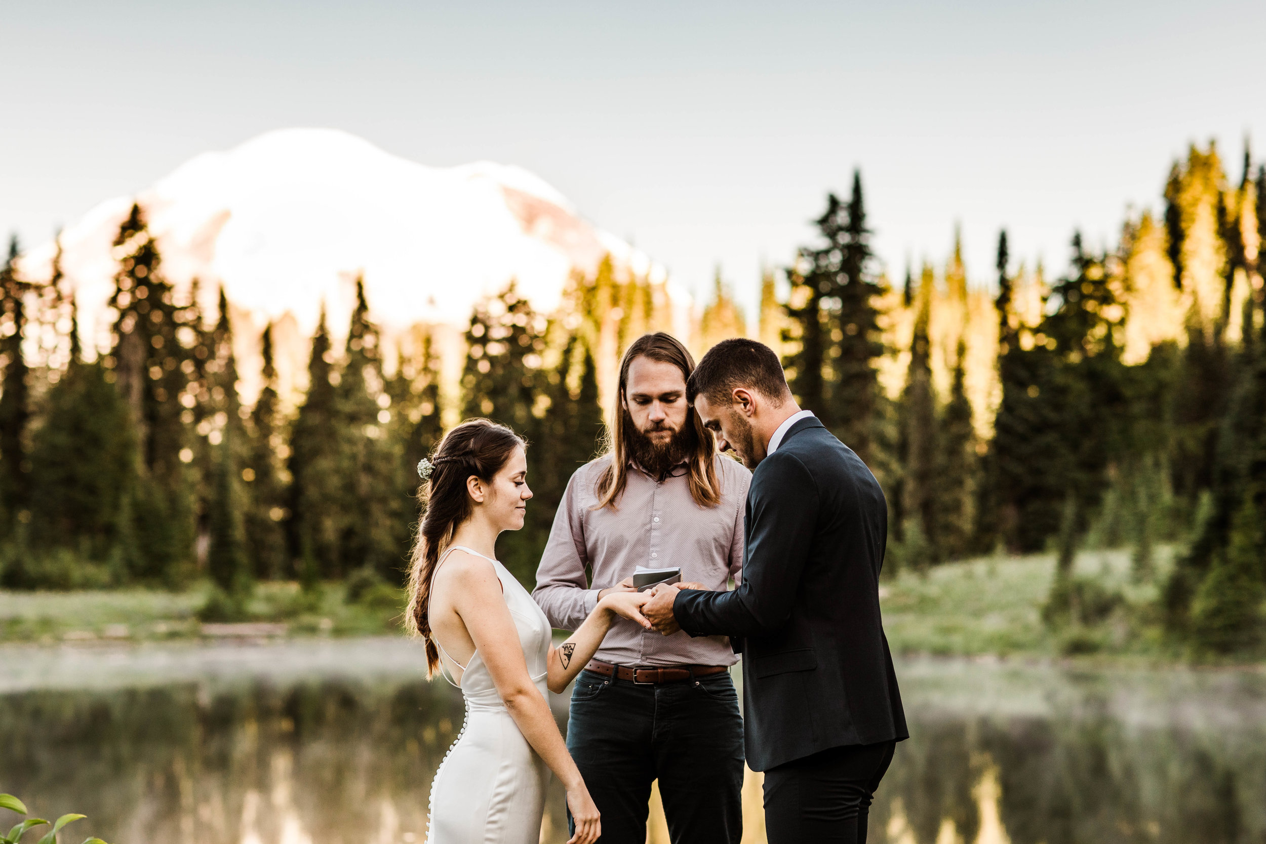 ring exchange during elopement ceremony in Mount Rainier | national park elopement photographers in Washington state