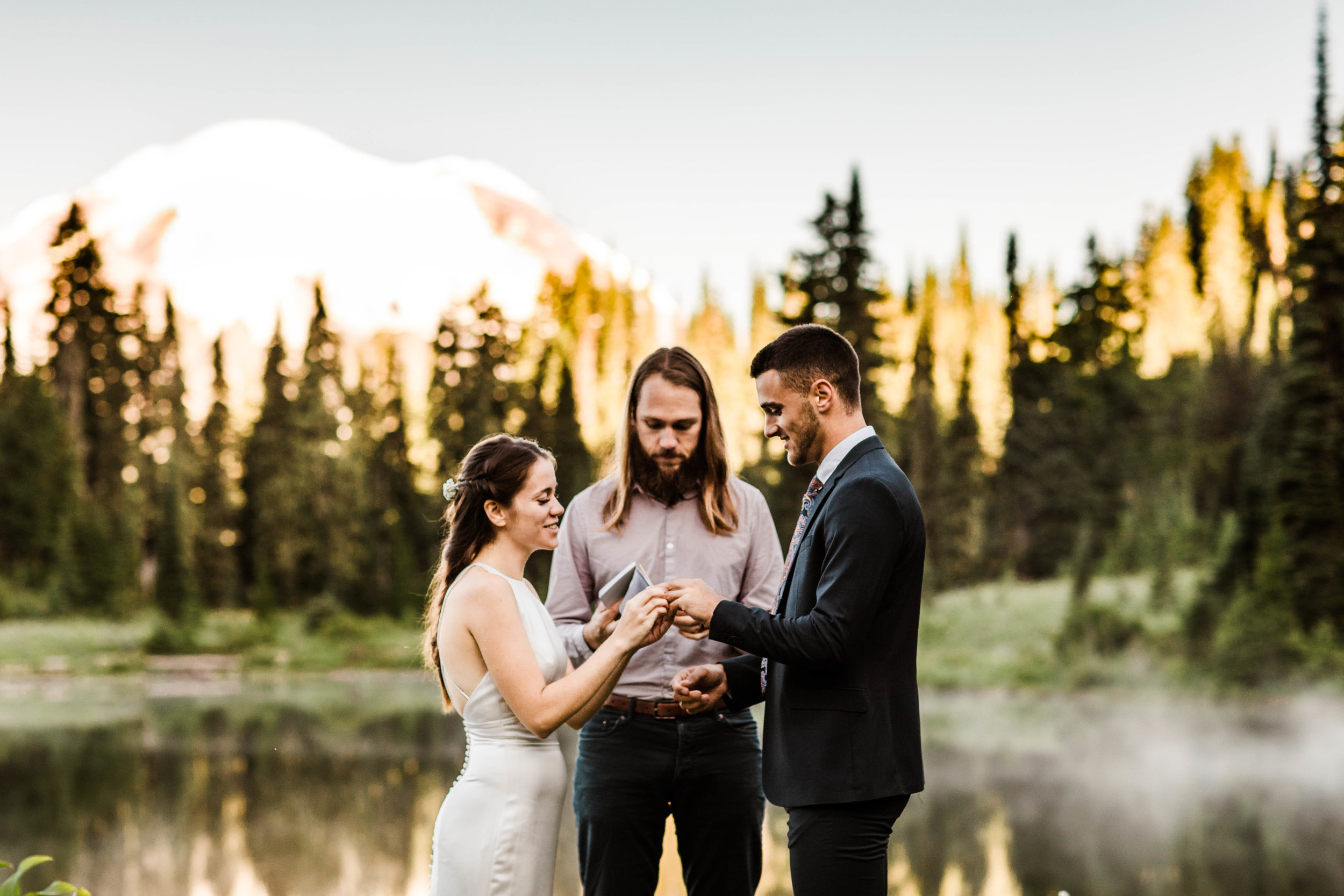 ring exchange during elopement ceremony in Mount Rainier | national park elopement photographers in Seattle Washington