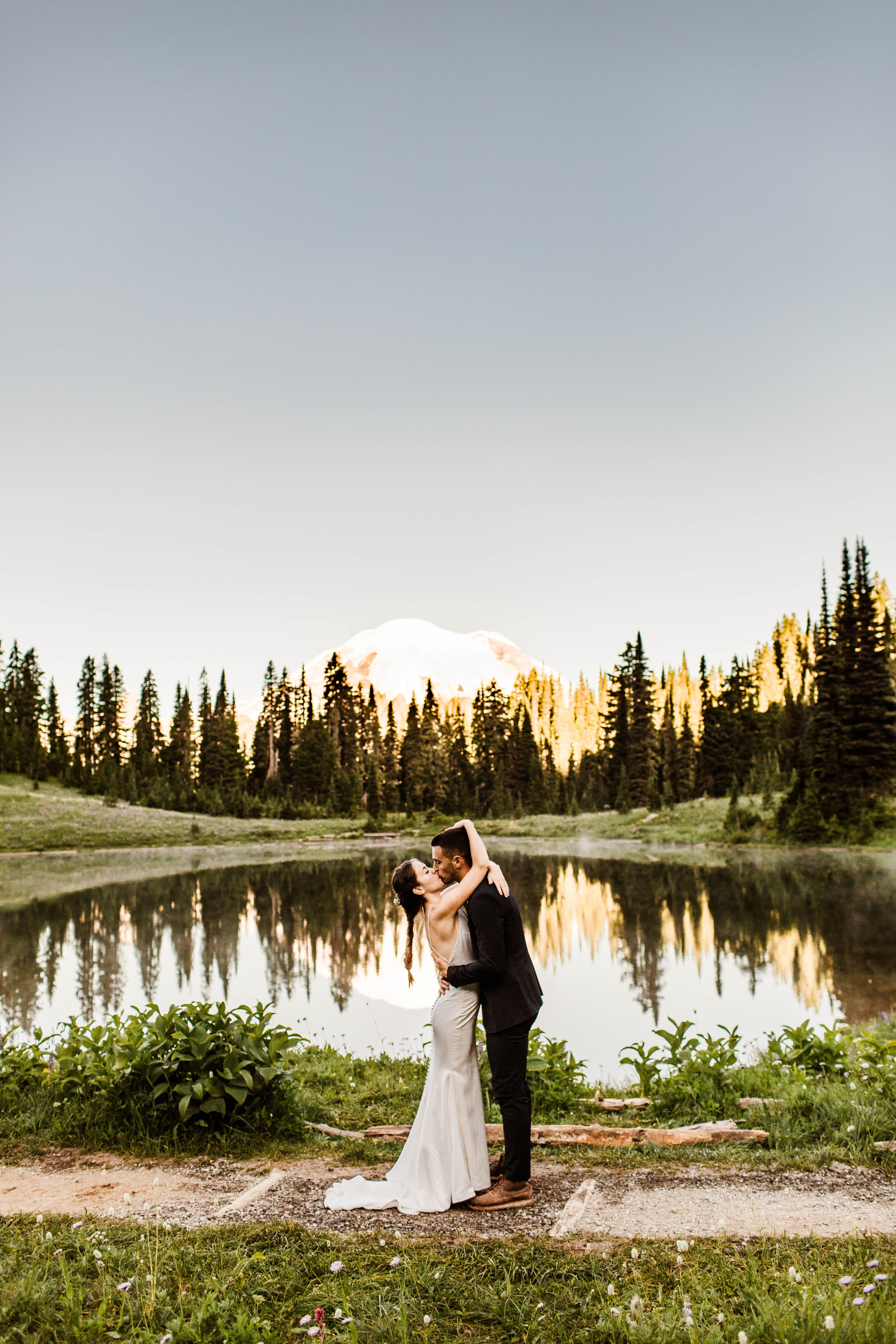 first kiss during elopement ceremony in Mount Rainier | national park elopement photographers in Washington state