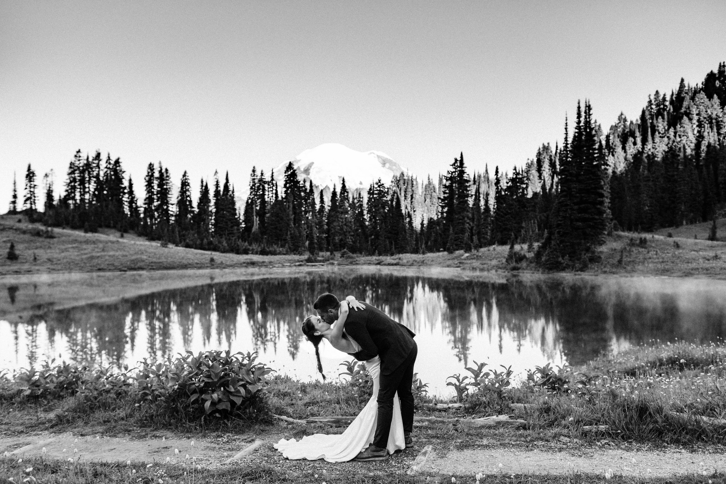 first kiss during elopement ceremony in Mount Rainier | national park elopement photographers in Seattle Washington