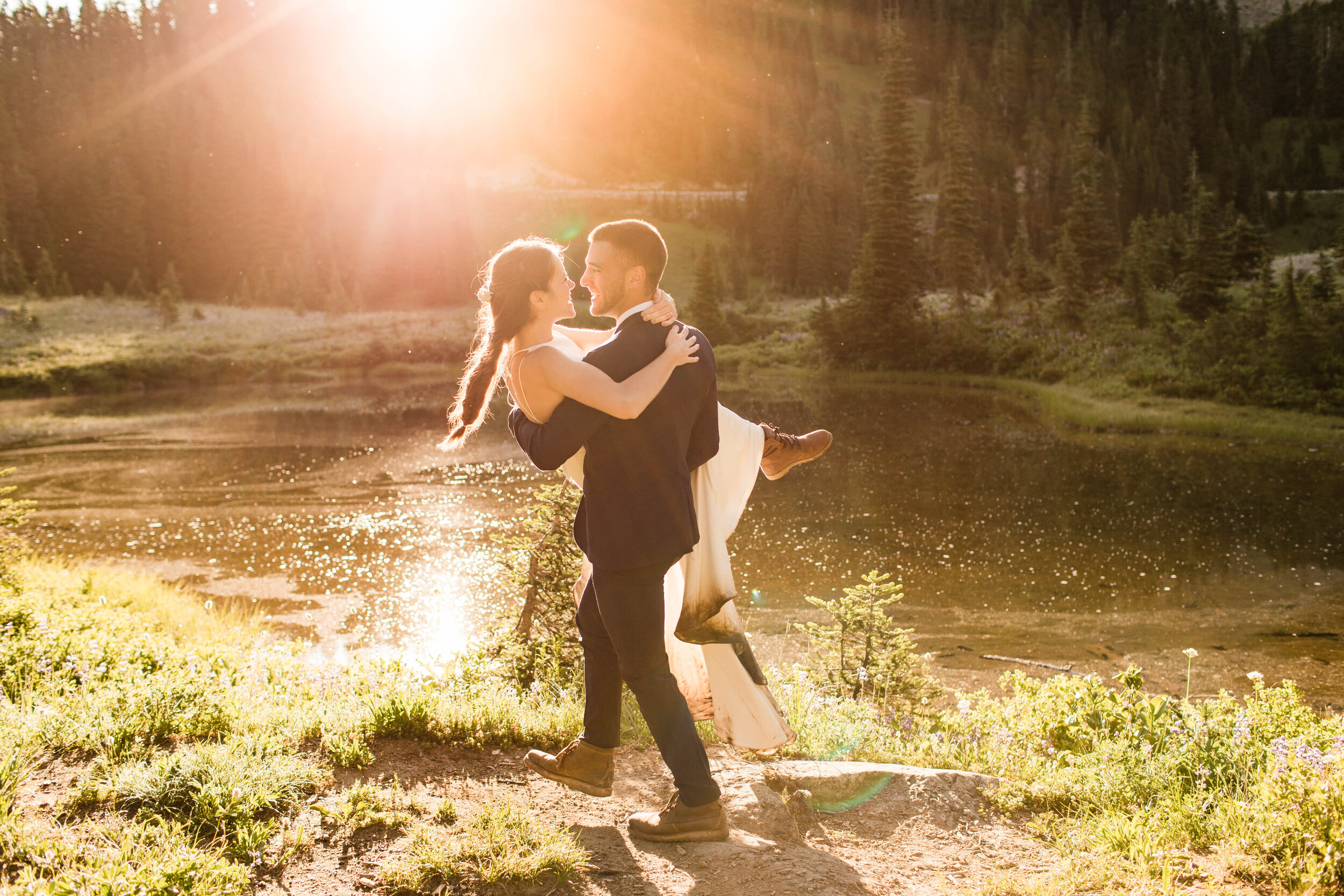 Mt Rainier Adventure Elopement with groom lifting the bride photographed by Colorado Elopement Photographers