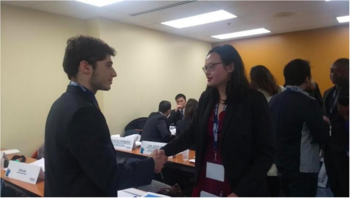 American and Russian representatives shaking hands