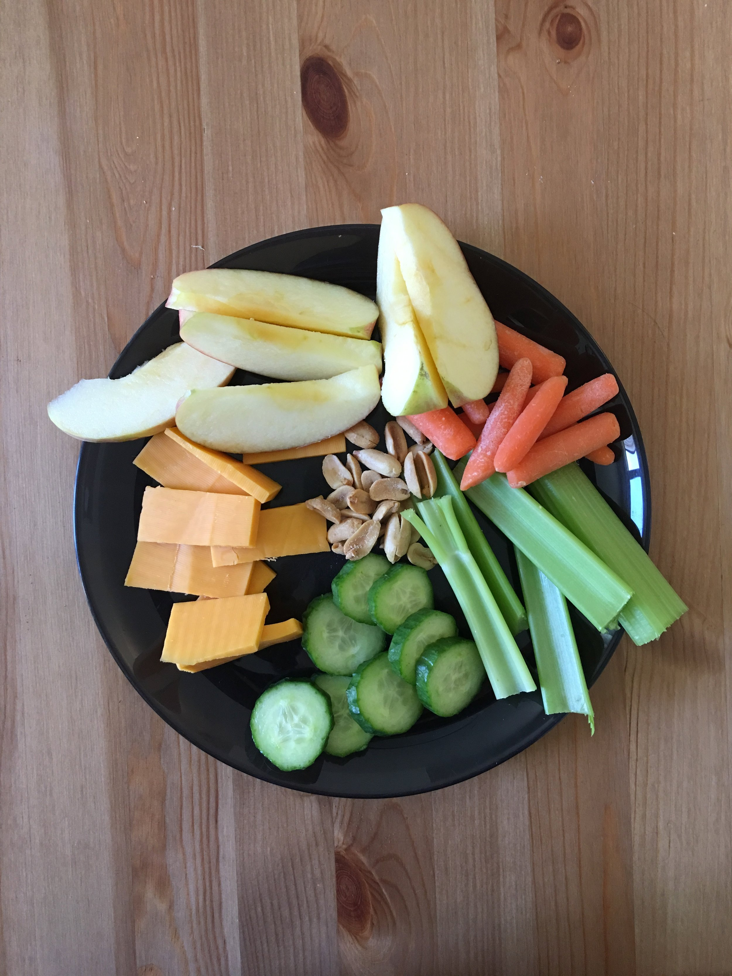 PROTEIN: 2 OZ CHEDDAR CHEESE / FRUIT: 6 OZ APPLE / VEGGIE: 6 OZ CELERY, CARROTS, CUCUMBERS / FAT: 0.5 OZ PEANUTS