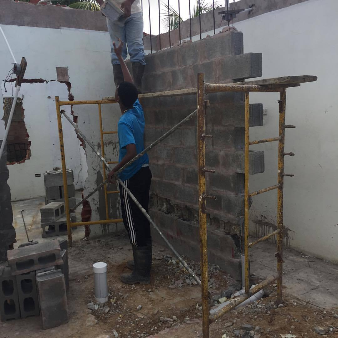 Surgical demolition. We're taking the wall apart block by block so we could reuse them.  #jaderenovation #savethatmoney #architecture #construction #trinidad  (at 500 Chaguanas)
