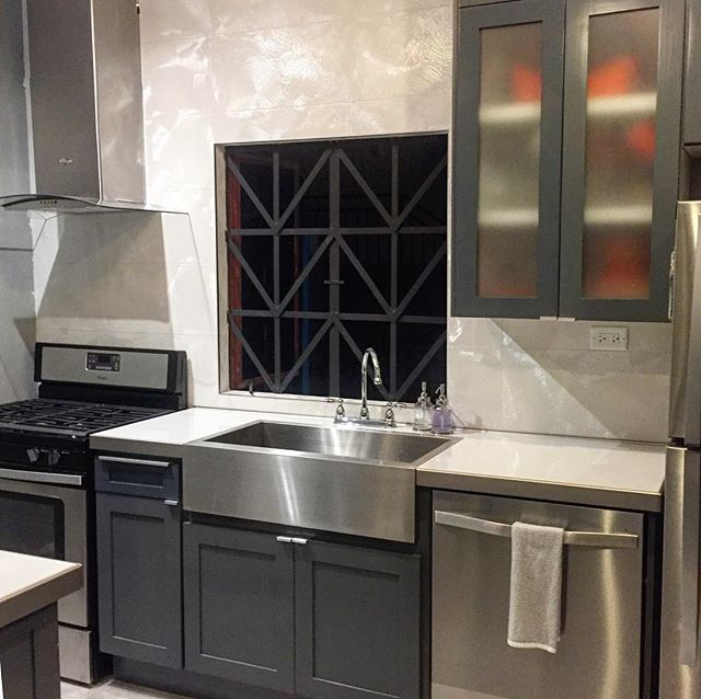 One way to maximize cabinet space in a small kitchen is take your uppers all the way to the ceiling. And because we're so stylish, we took the backsplash there too #jaderenovation #homedecoration @ajdesignedtt #swanky