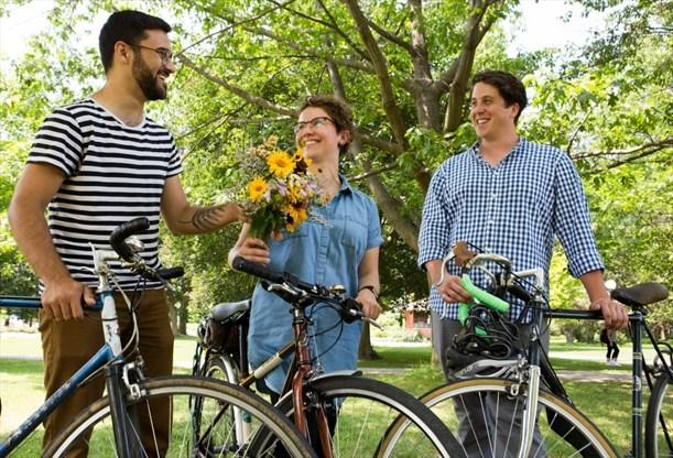 Sam Nabi, left, Alex Szaflarska and Sean Campbell's new cycling and folk music festival will celebrate the region's countryside line and protect farmlands by encouraging a lifestyle that includes biking to St. Jacobs for fresh flowers.  - Vanessa Tignanelli, Record staff
