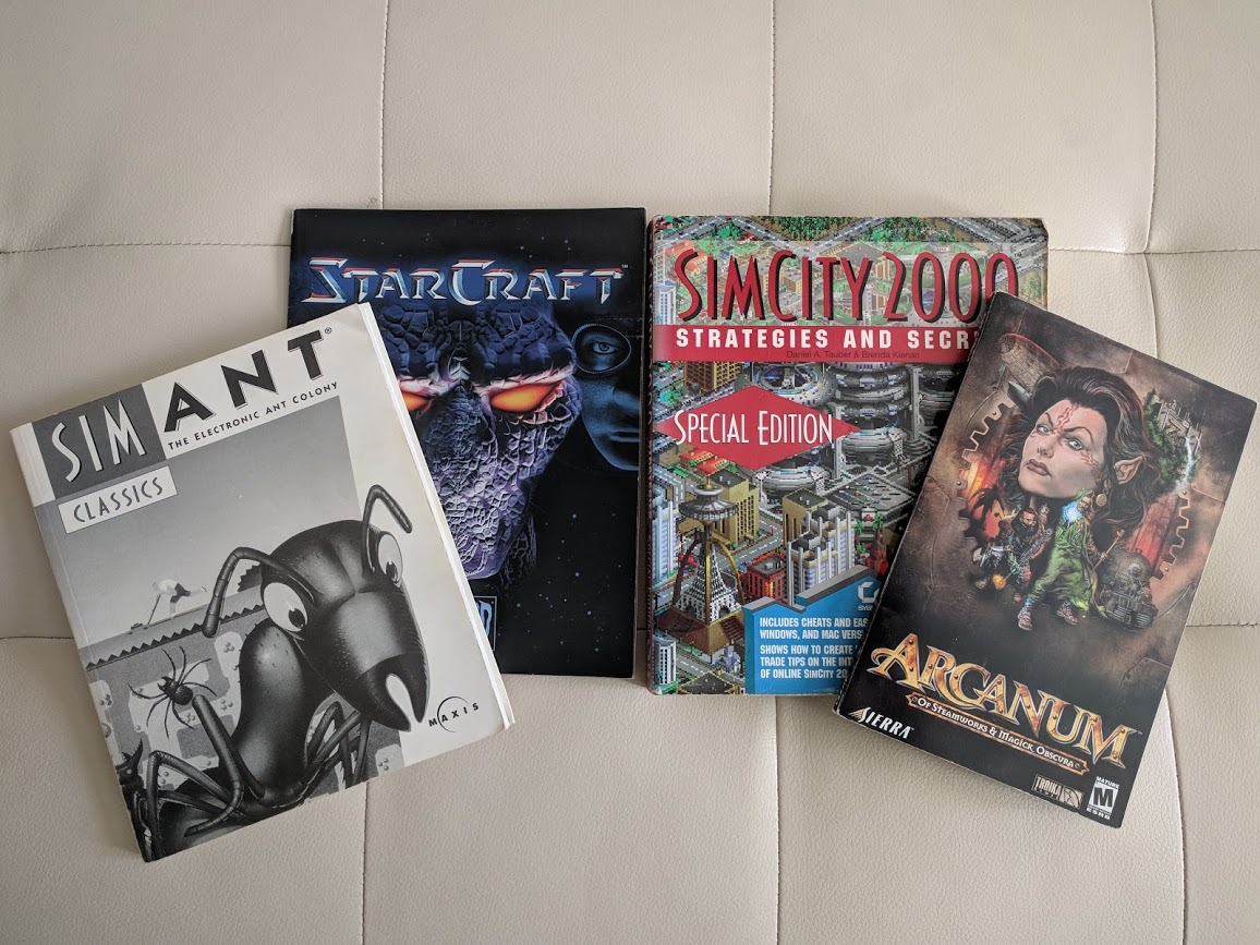 Some of my PC game instruction manuals and guides.