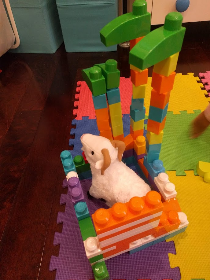 """Behold, """"Goat Castle,"""" complete with green flags towering over the castle's master."""