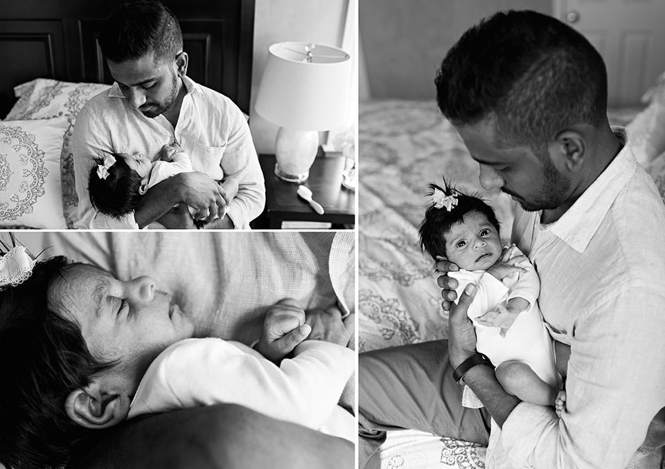dad holding newborn daughter on bed southington connecticut newborn photographer