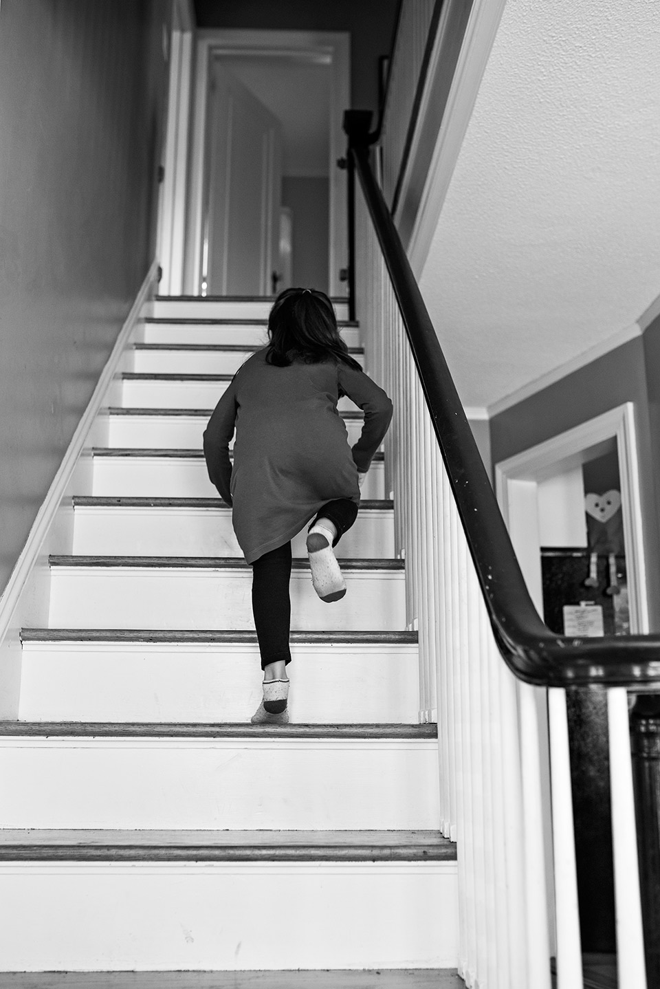 girl climbing up stairs to her bedroom west hartford ct family documentary photography