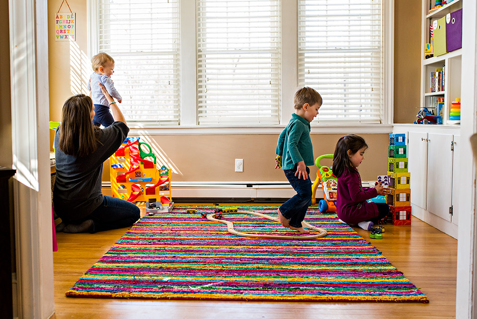 mom and children playing in their playroom with toys west hartford ct family documentary photography