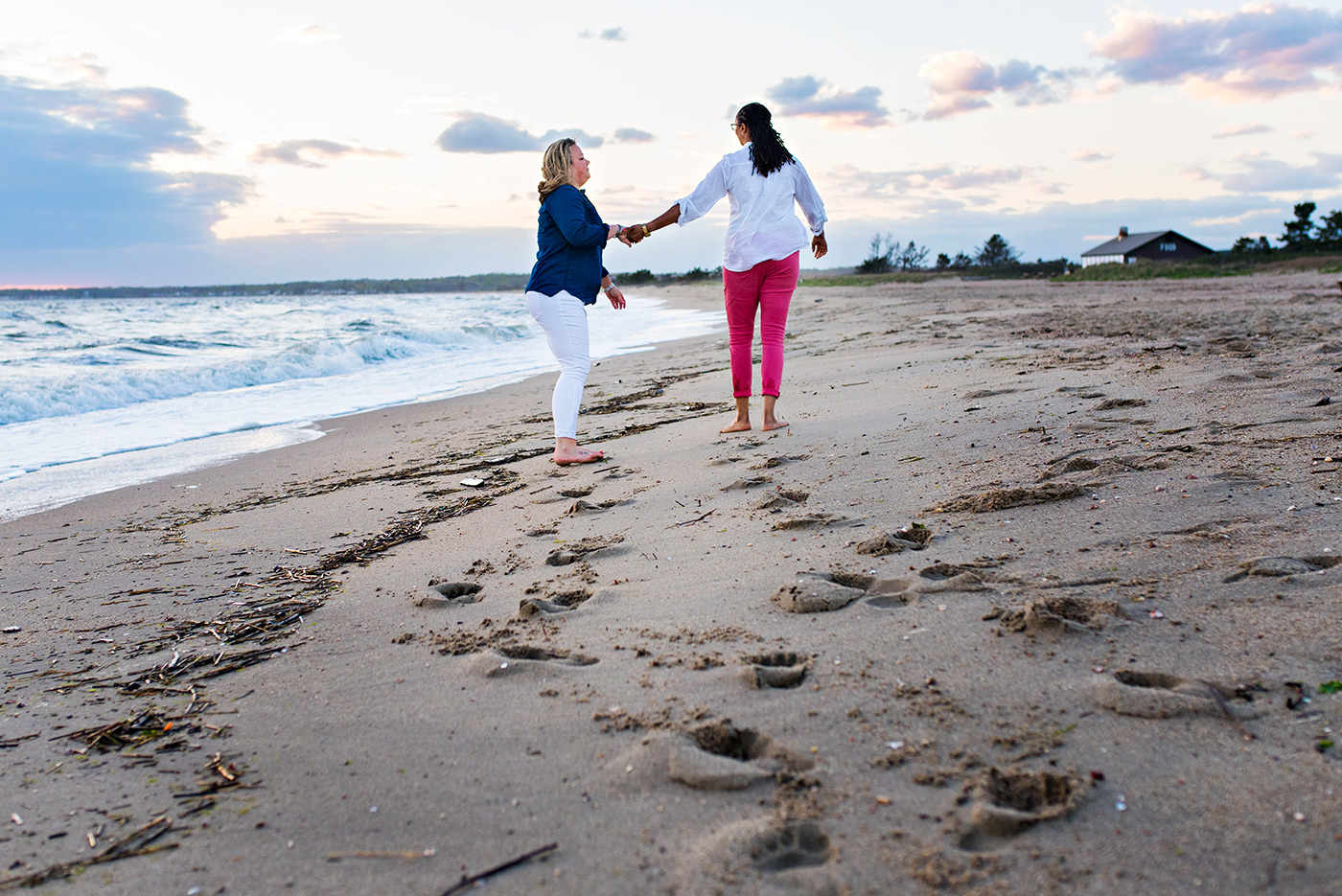 women dancing on beach at sunset madison connecticut wedding photographer