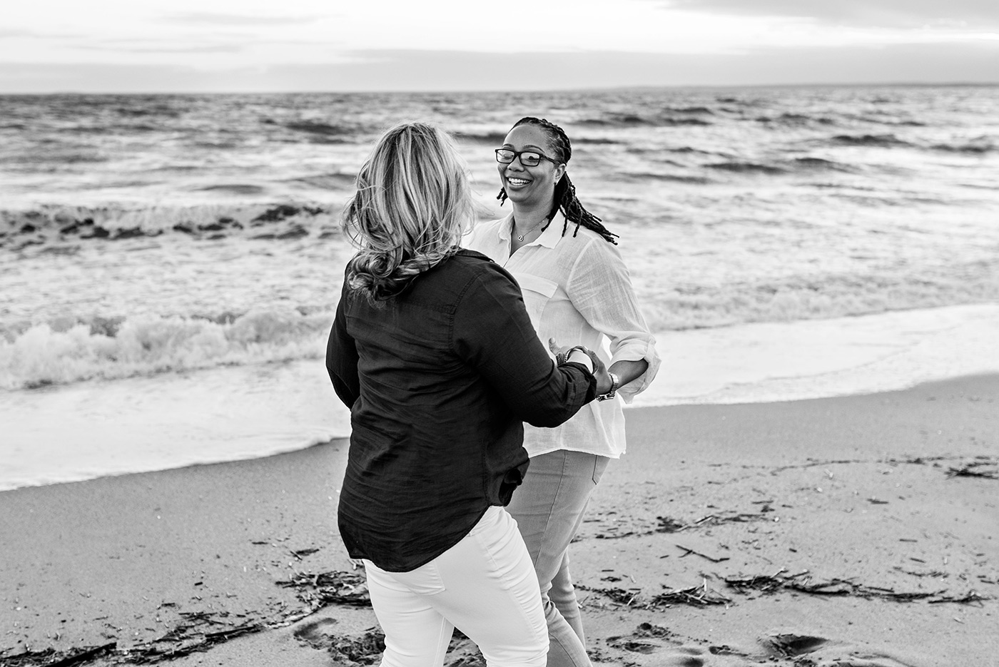 engaged couple dancing on beach madison connecticut weddingphotography