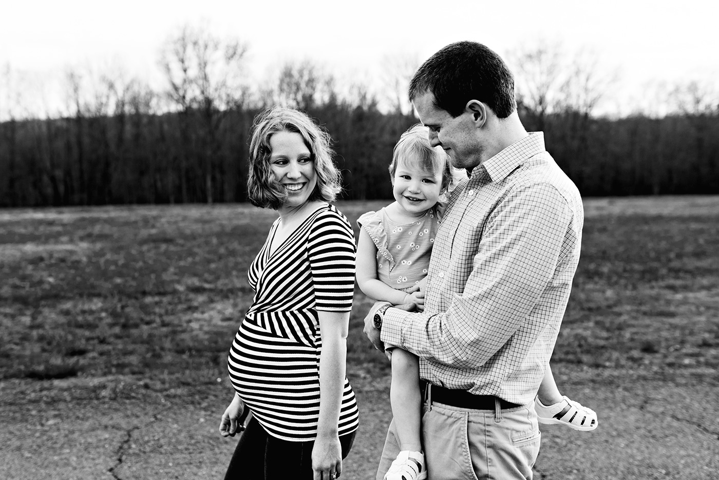 lifestyle photography  pregnant mother walking with husband and daughter Haddam, Connecticut Maternity photography