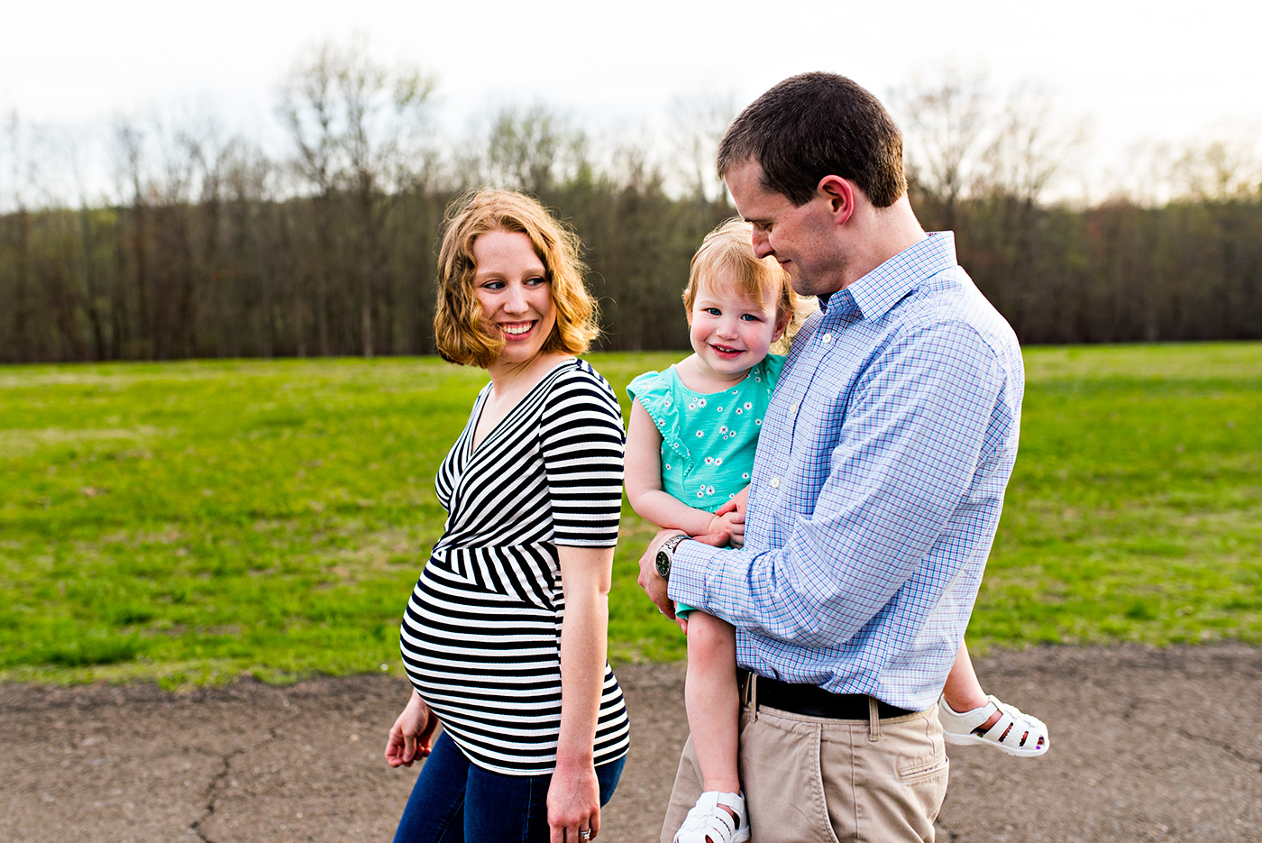 family walking in field at haddam meadows in haddam connecitcut lifestyle maternity photography