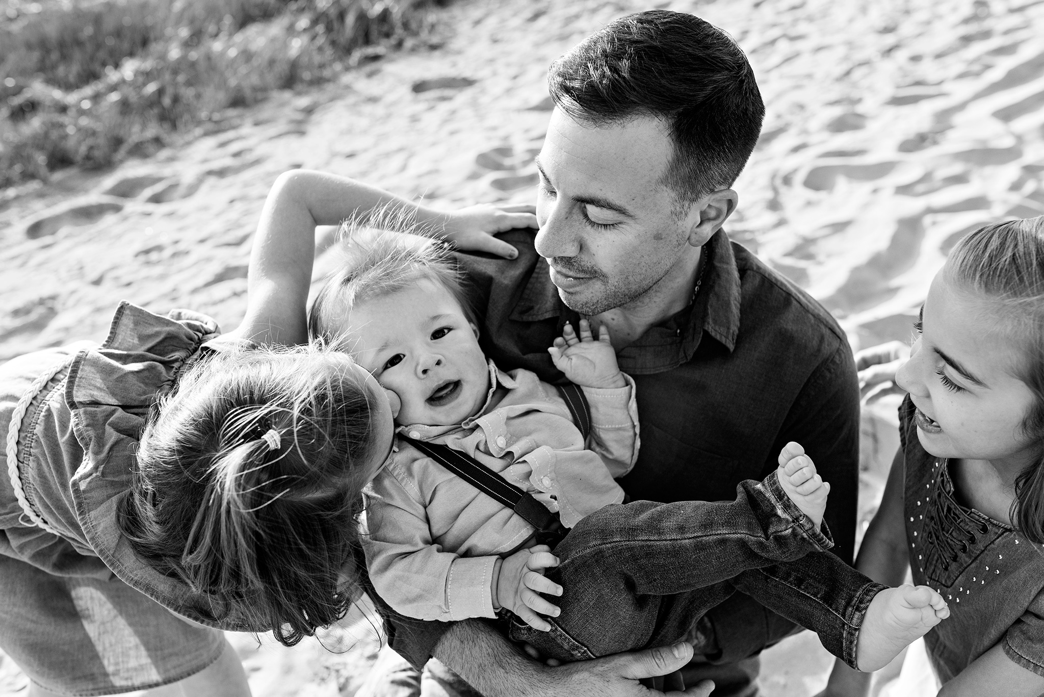 sister kissing brothers cheek lifestyle family photography ct