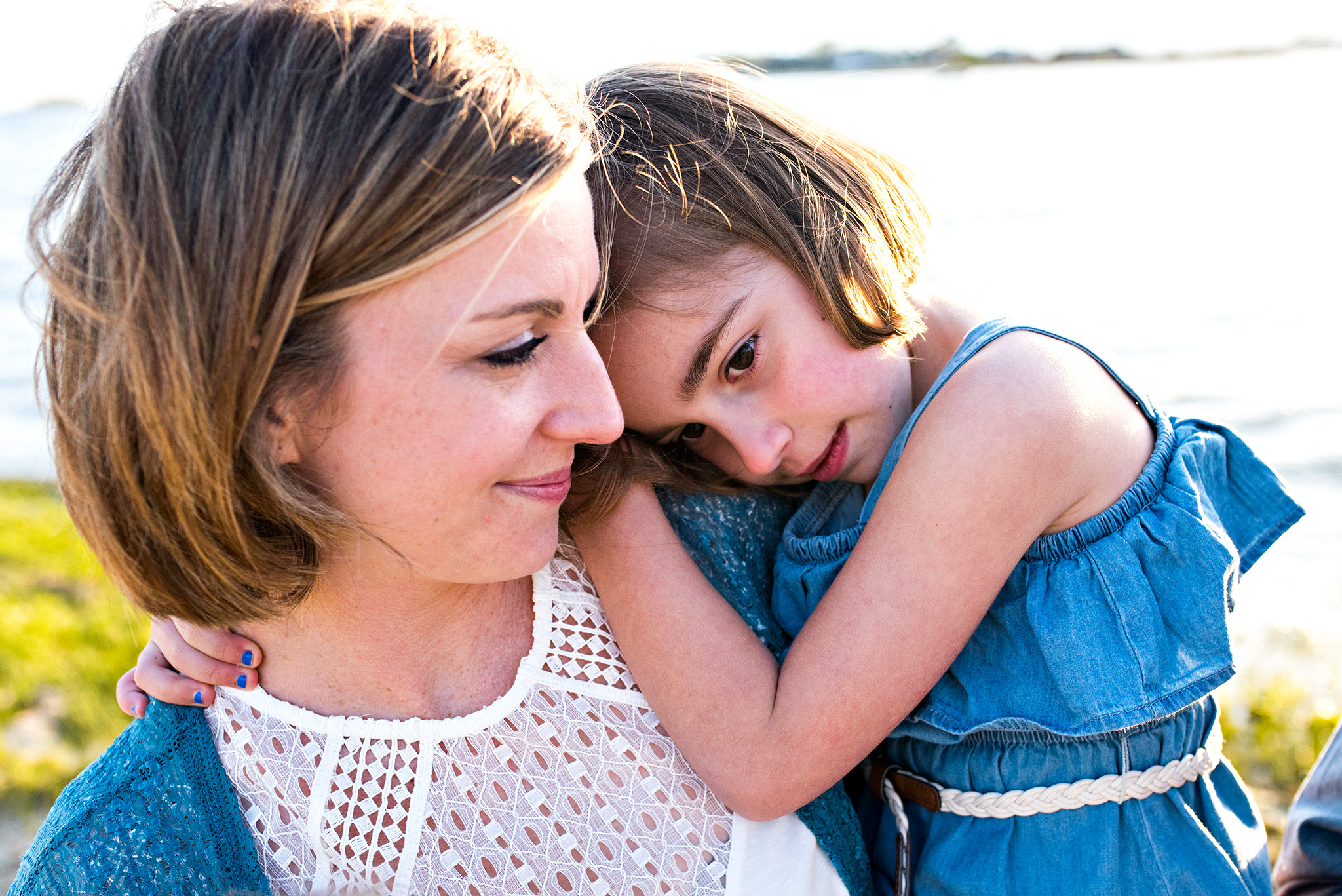 mom snuggling daughter during family photography ct clinton beach