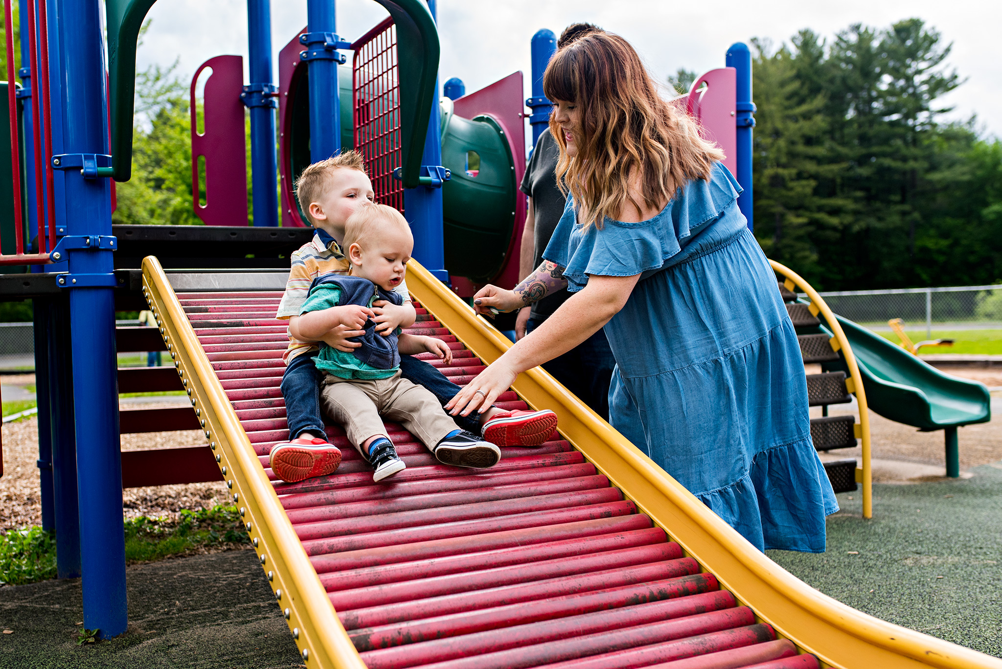 brothers going down slide documentary family photographer ct