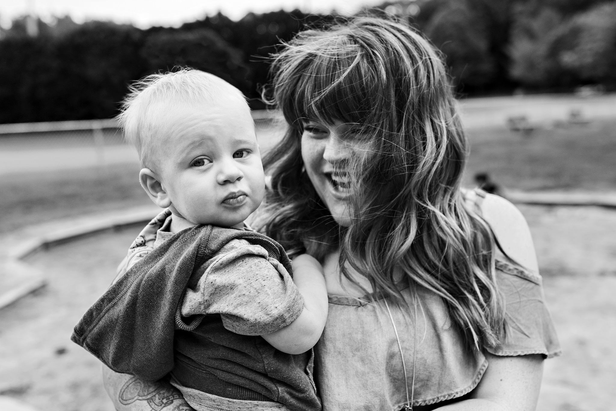 mom smiling holding son connecticut family photography panthorn park plainville ct