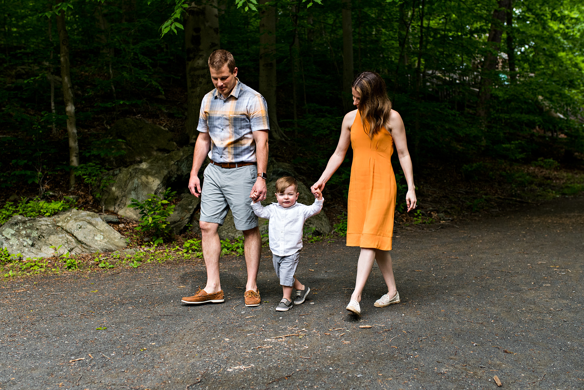 parents holding hands with son stamford, ct nature center conneticut photography