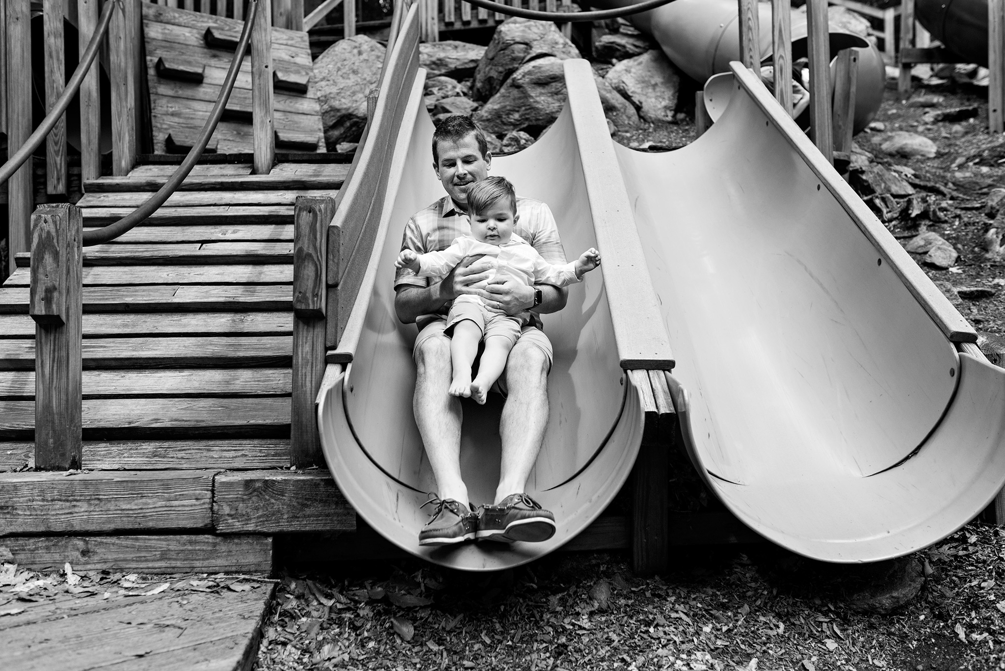 dad on slide with child stamford, ct nature center photography
