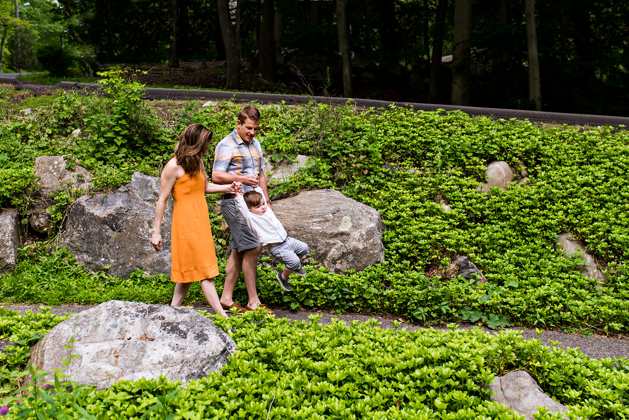 family holding hands stamford, ct nature center connecticut photography