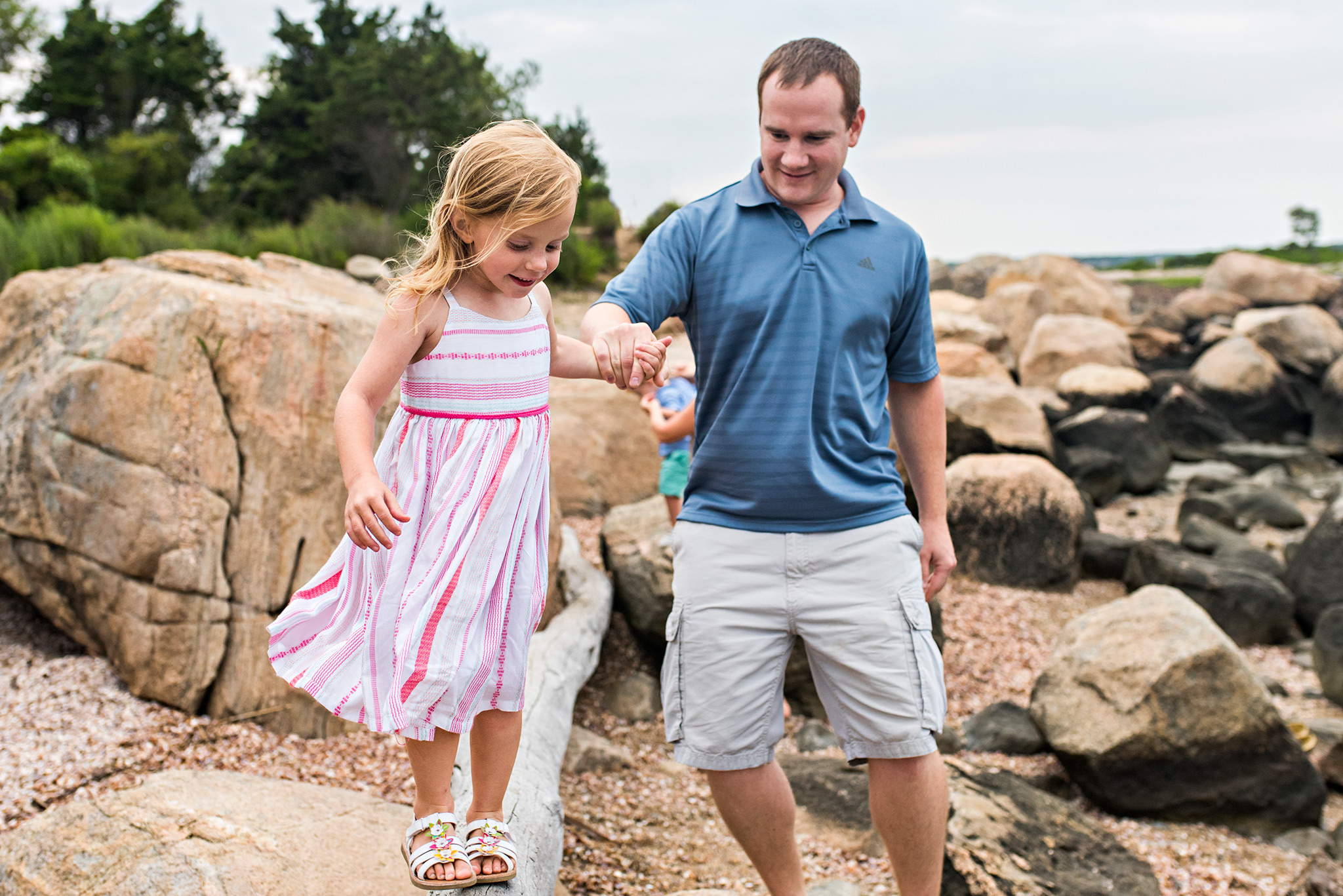 dad and daughter holding hands connecticut family photographer