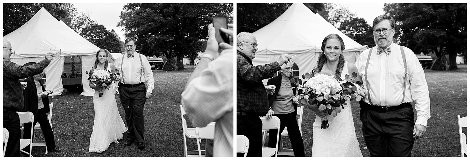 father and daughter walking down the isle in a backyard wedding in connecticut