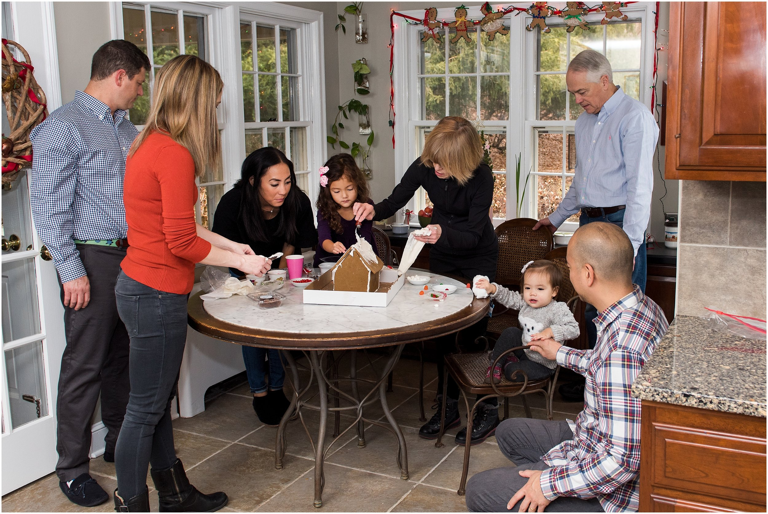 decorating gingerbread house, ct family photography
