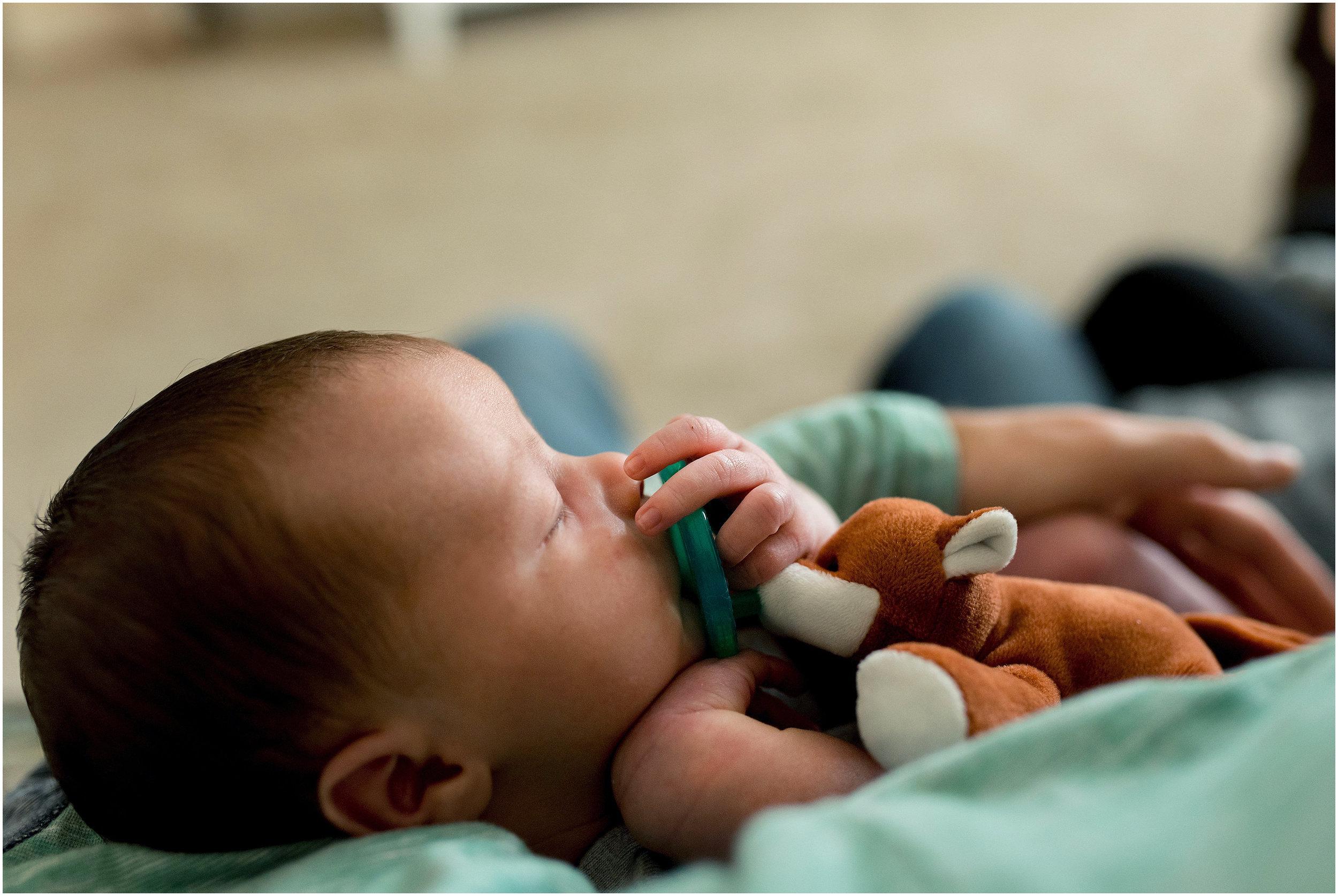 newborn sleeping with pacifier during ct newborn photography