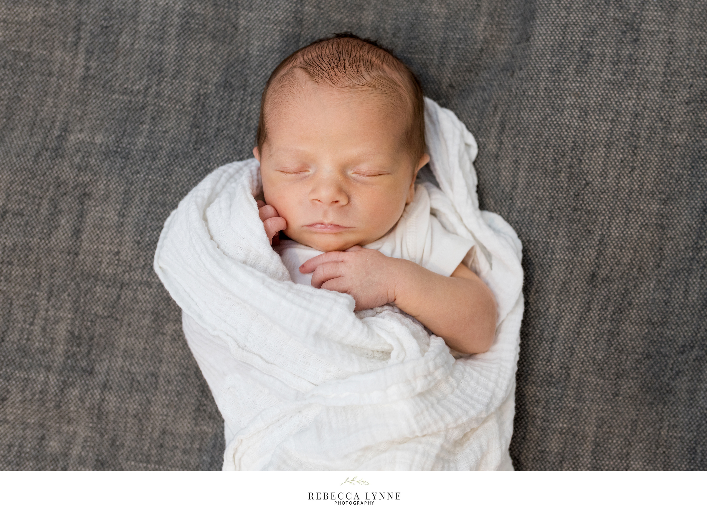 newborn baby swaddled on couch. in home newborn photographer ct