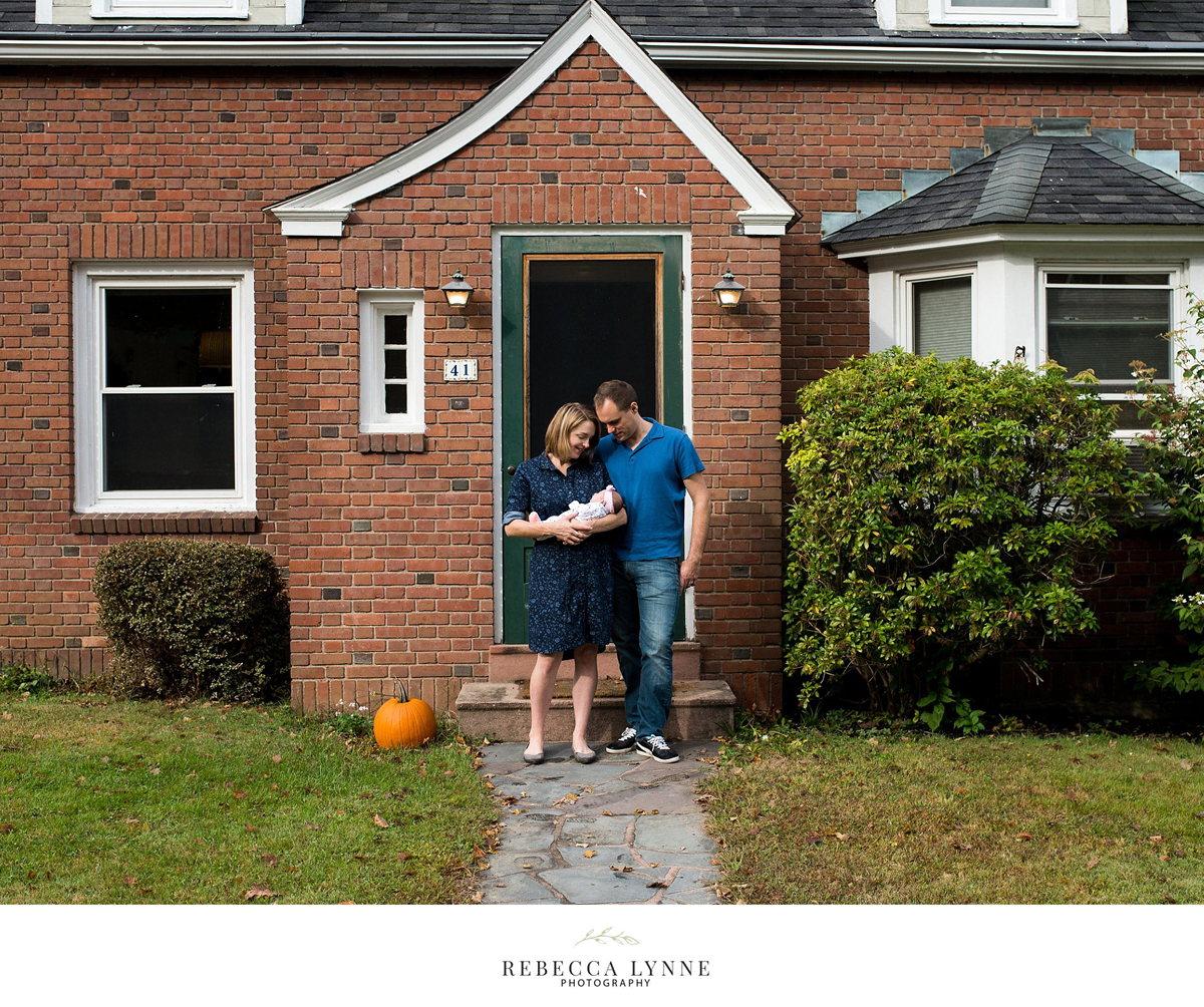 lifestyle newborn photography in front of family's home