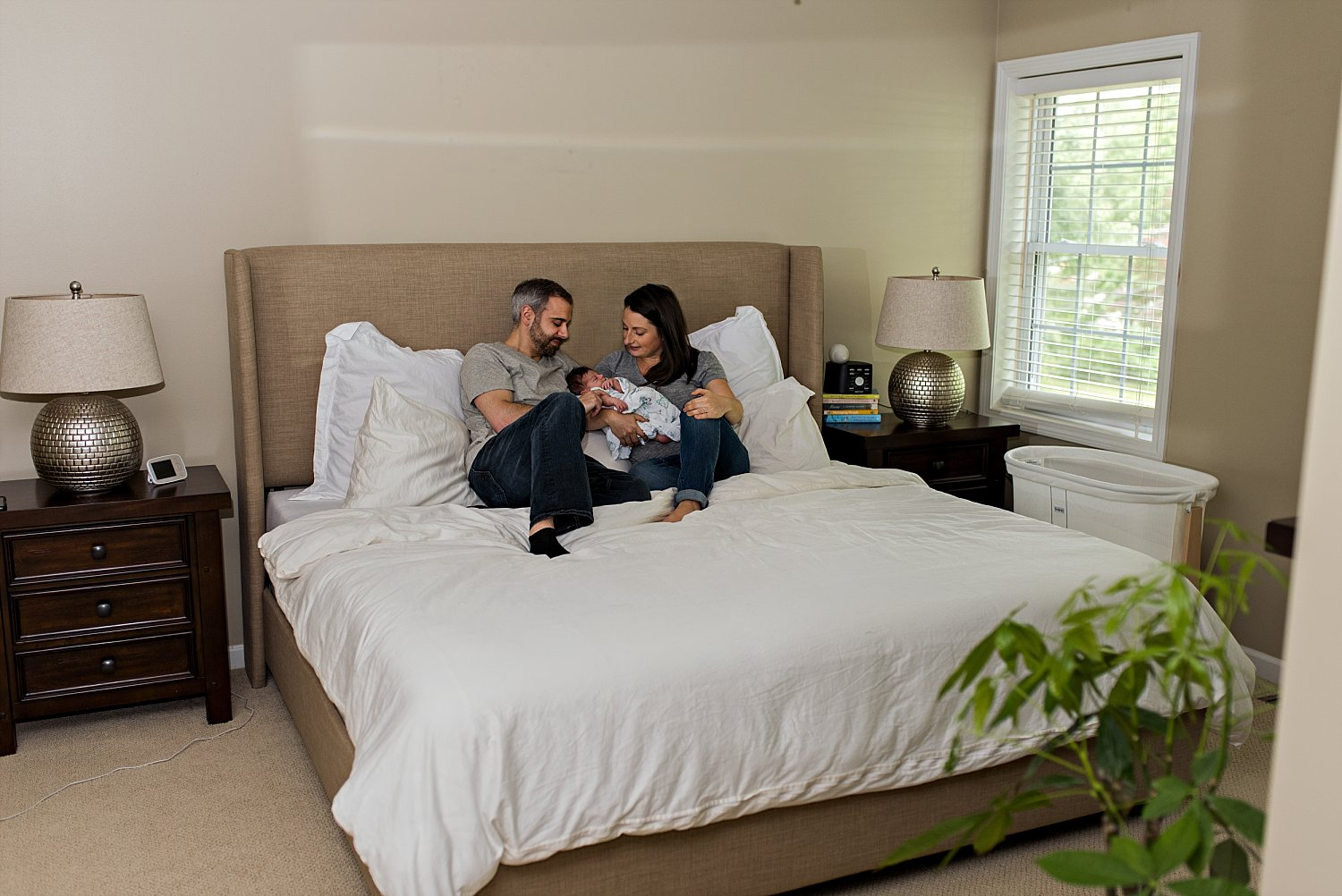 newborn naturally posed with mom and dads bed during at home newborn photography CT