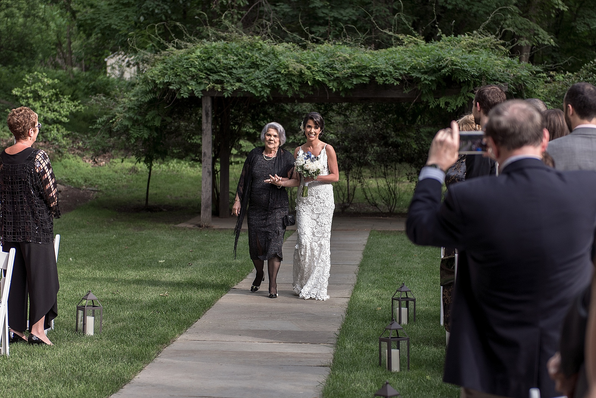 bride and mother walking down isle connecticut wedding