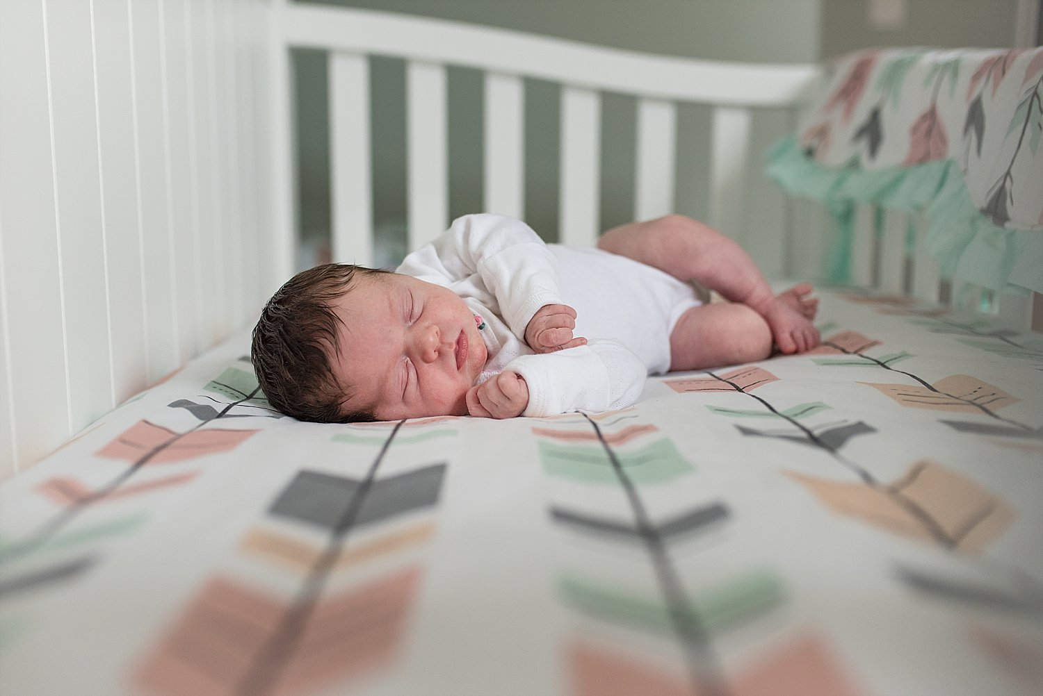 at home newborn photography session in hartford county. baby sleeping in crib